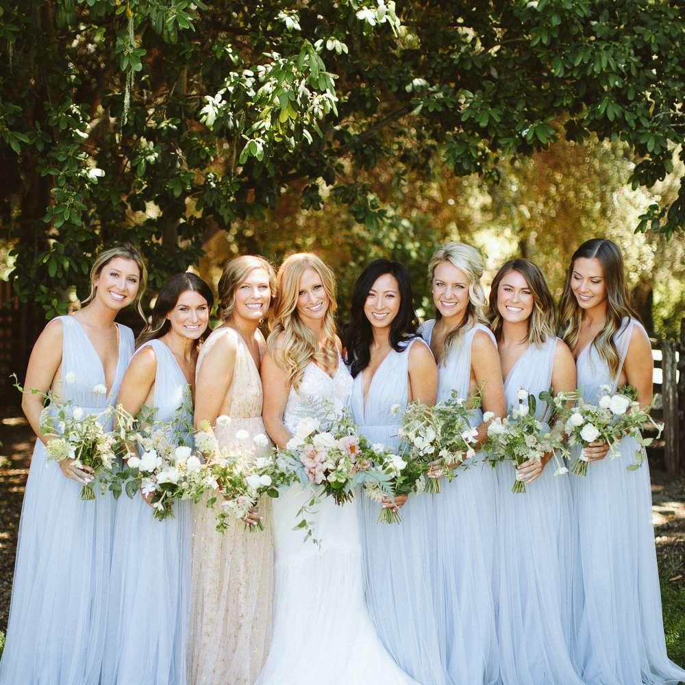 <p>bride and bridesmaids in blue</p><br><br>