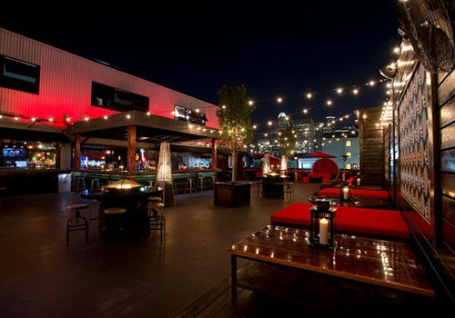 Rooftop bar with string lights