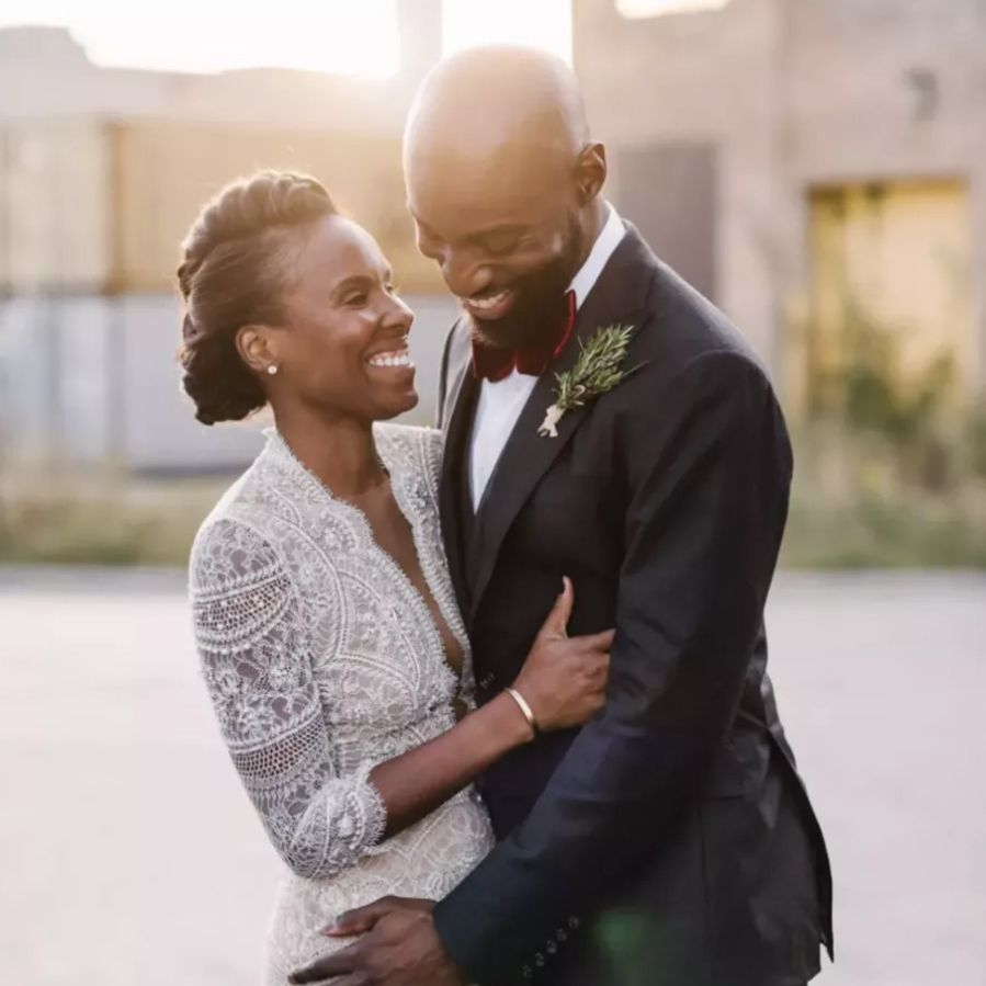 Bride with faux hawk laughing with groom