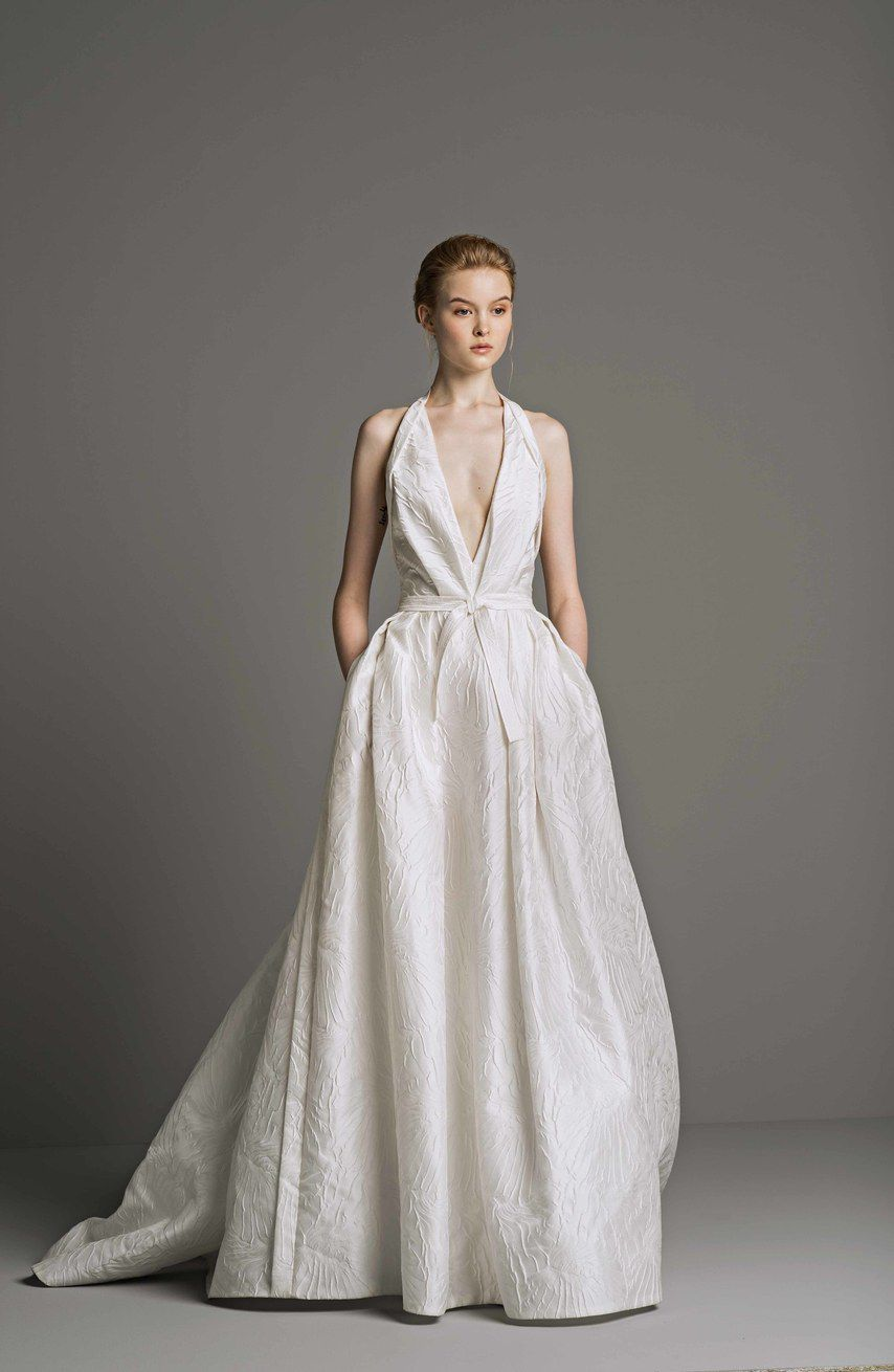 Model in V-neck white wedding gown with pockets