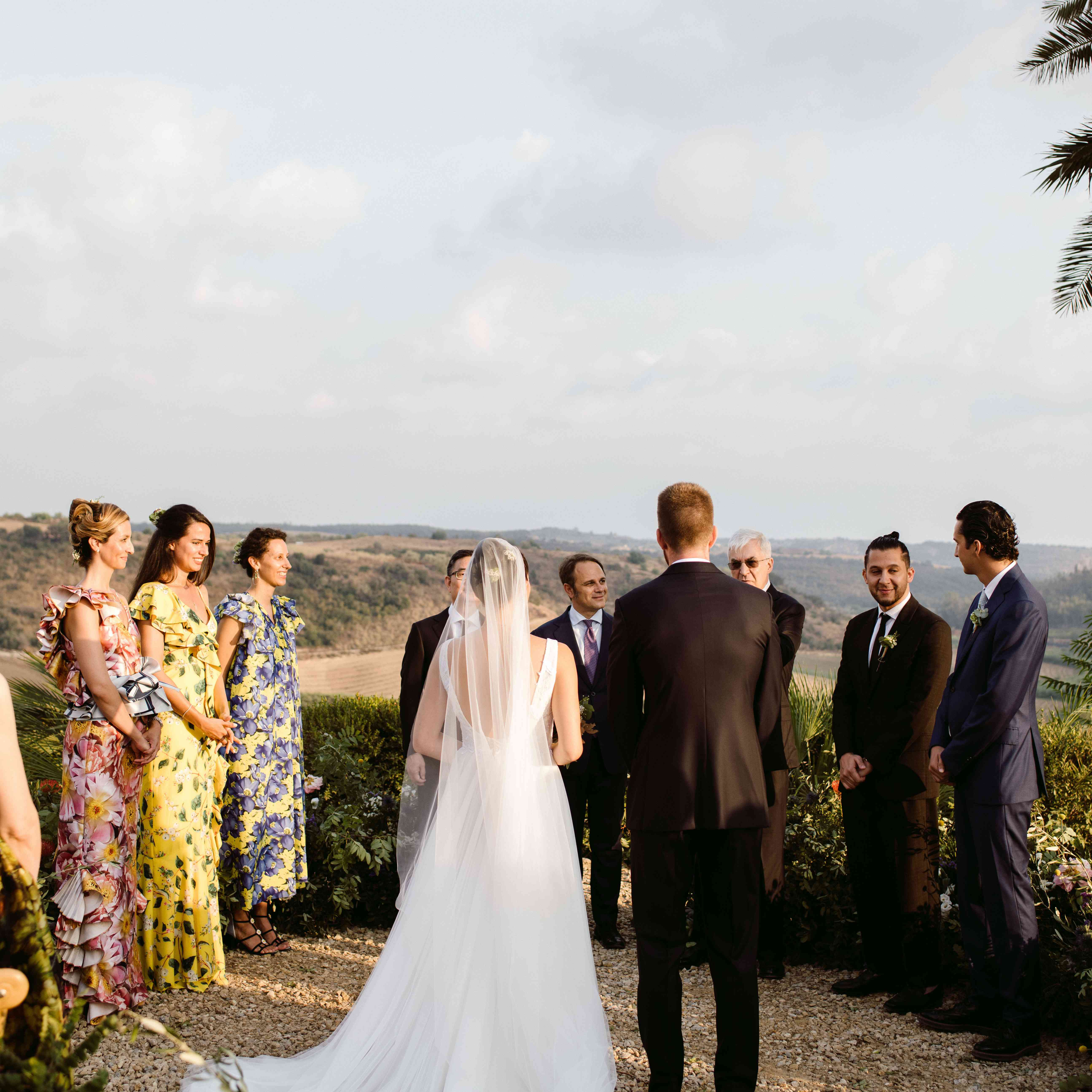 Bride and groom at the altar with bridesmaids and groomsmen