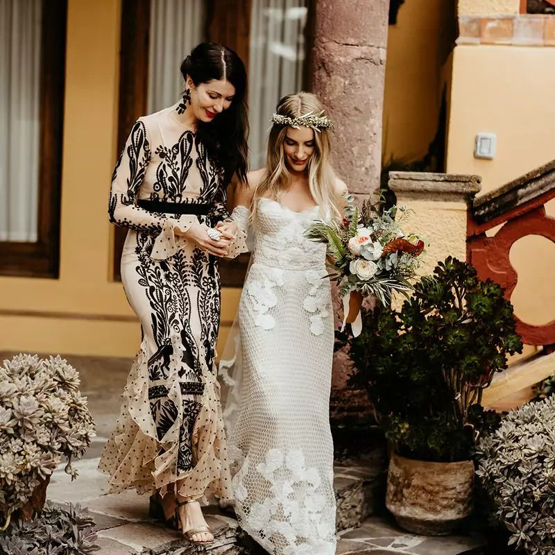Bride with mom walking down the aisle