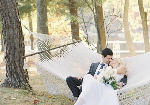 Urban-Inspired Camp Wedding Couple Sitting On Hammock
