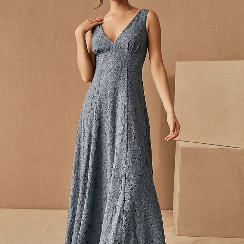 Model in a light blue sleeveless allover lace dress with a v-neck