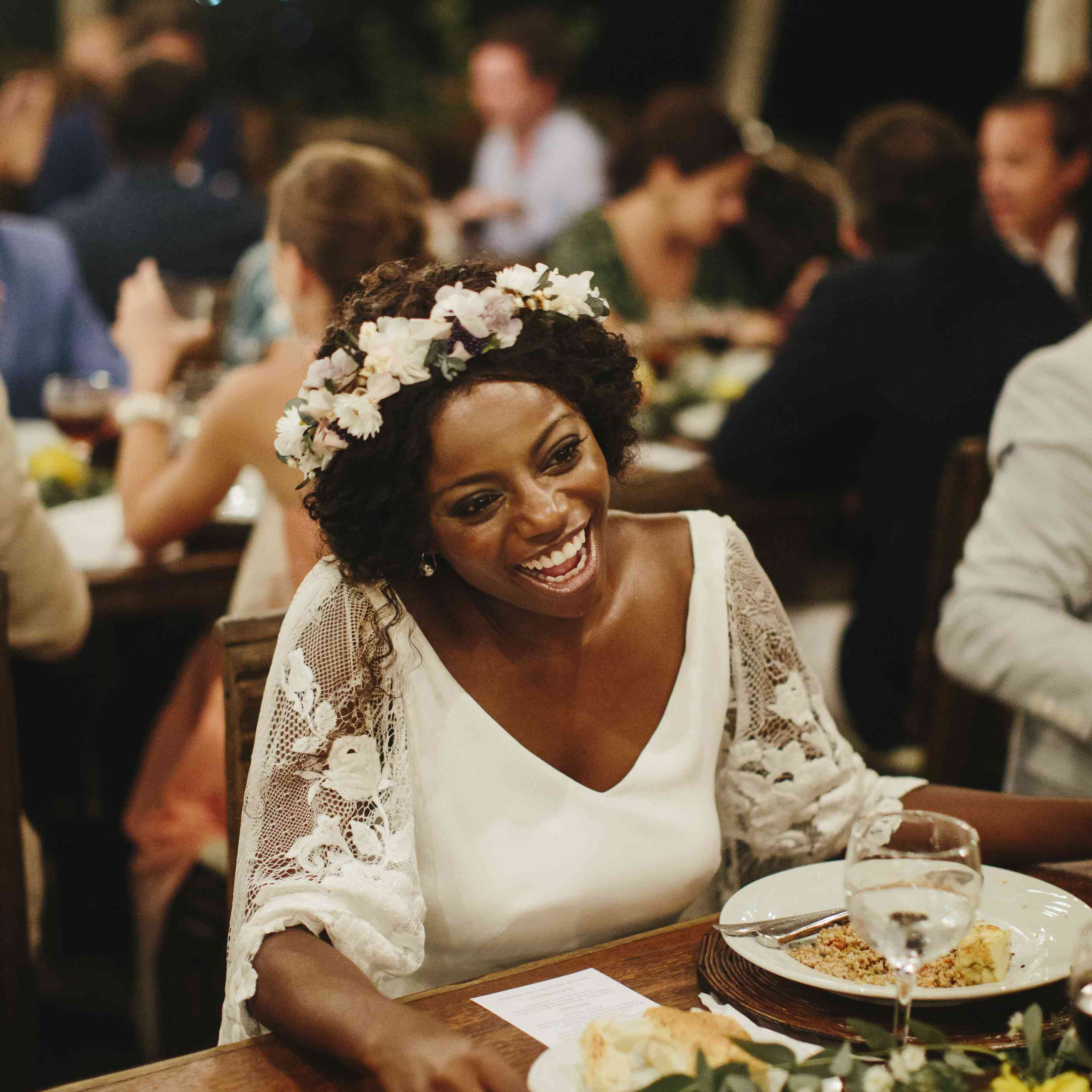 bride smiling glowing at reception dinner