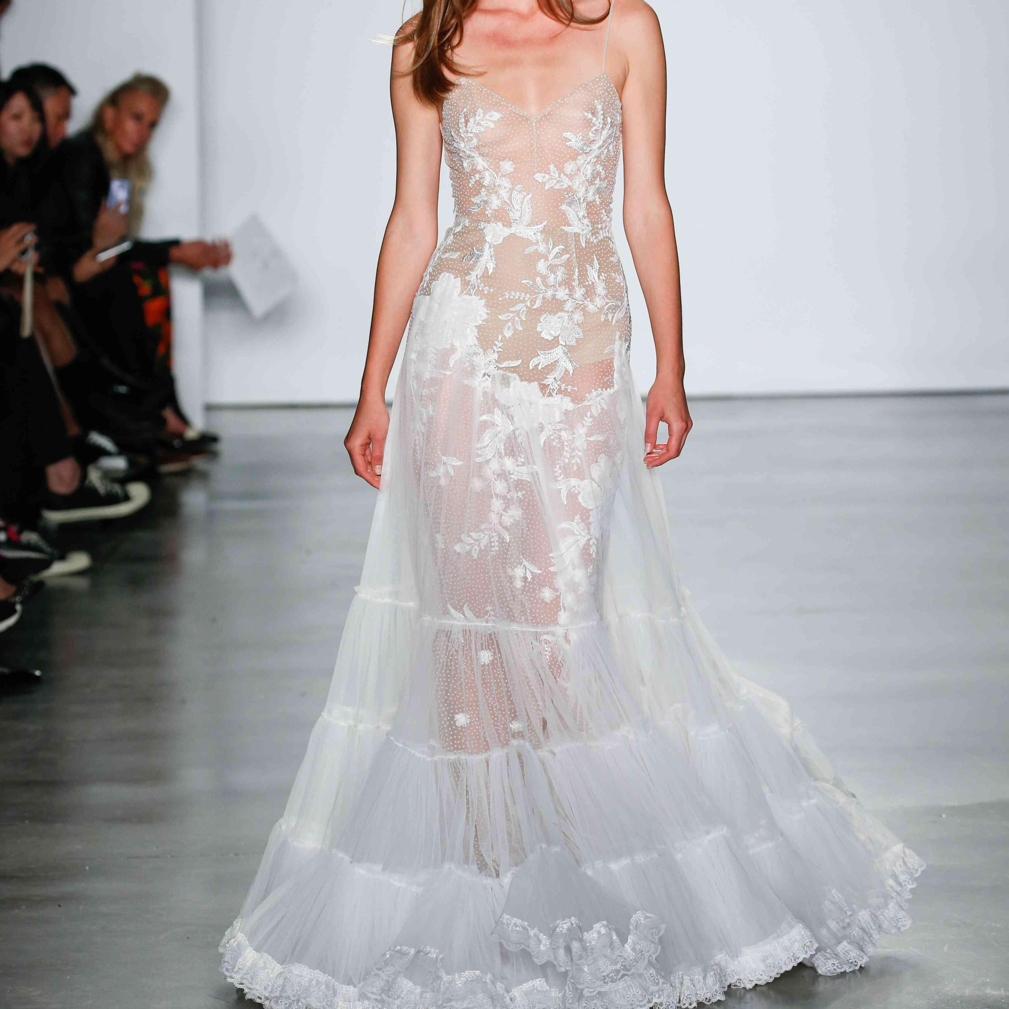 Model in sheer embroidered slip dress