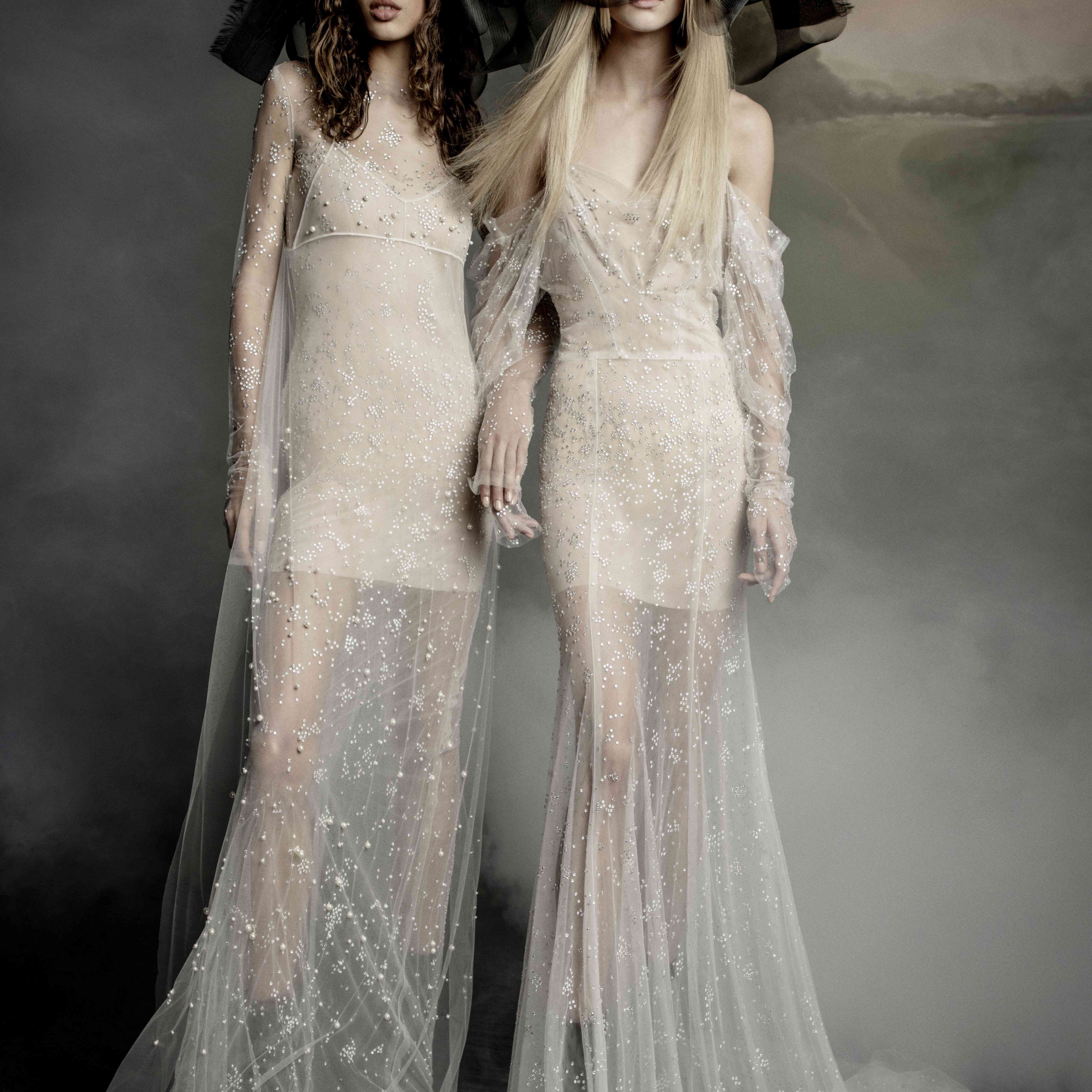 Two models in sheer tulle column gowns with crystals