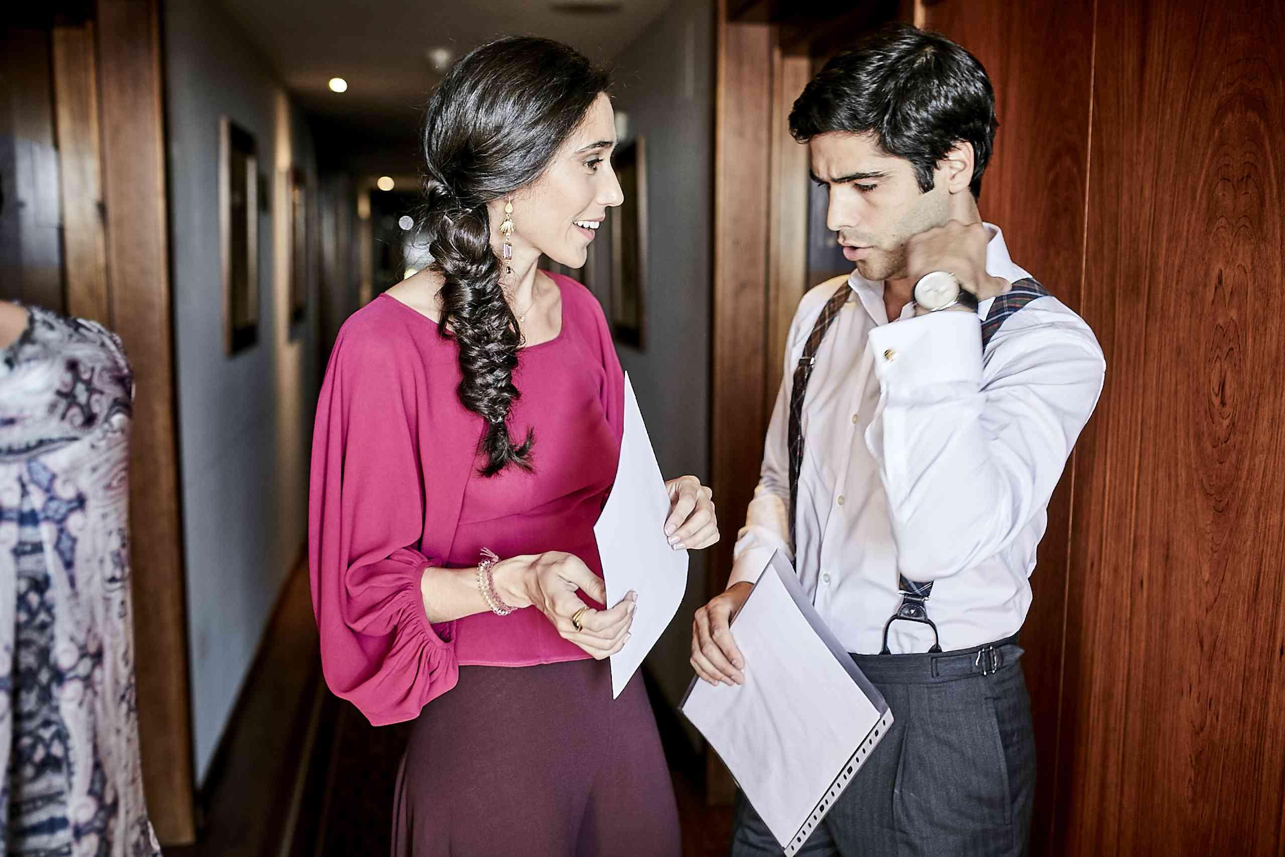 Man and woman discussing paperwork
