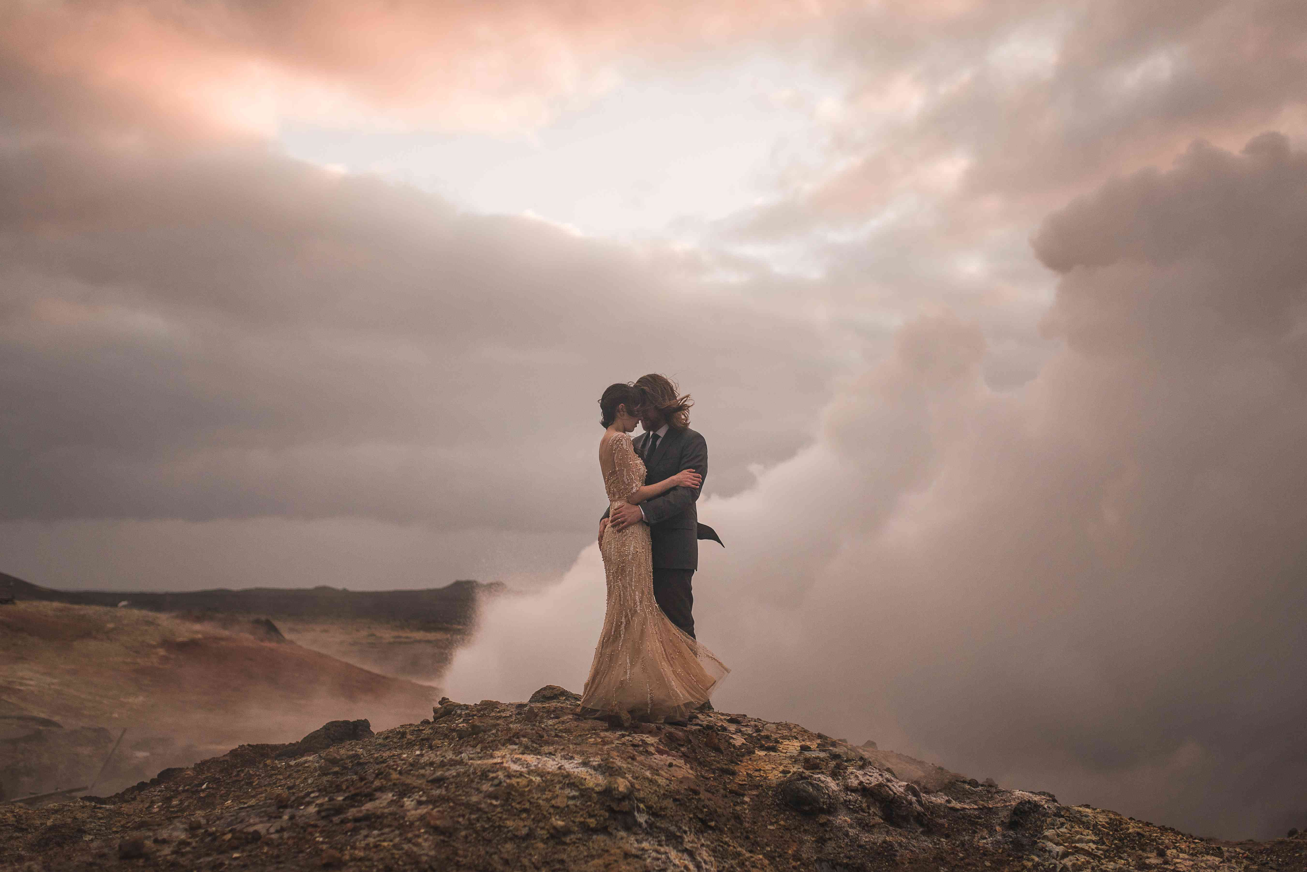 Couple holding each other on a volcanic crater in Iceland