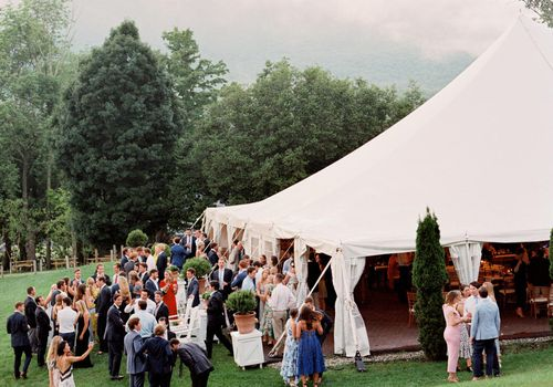 Wedding guests outside of tent