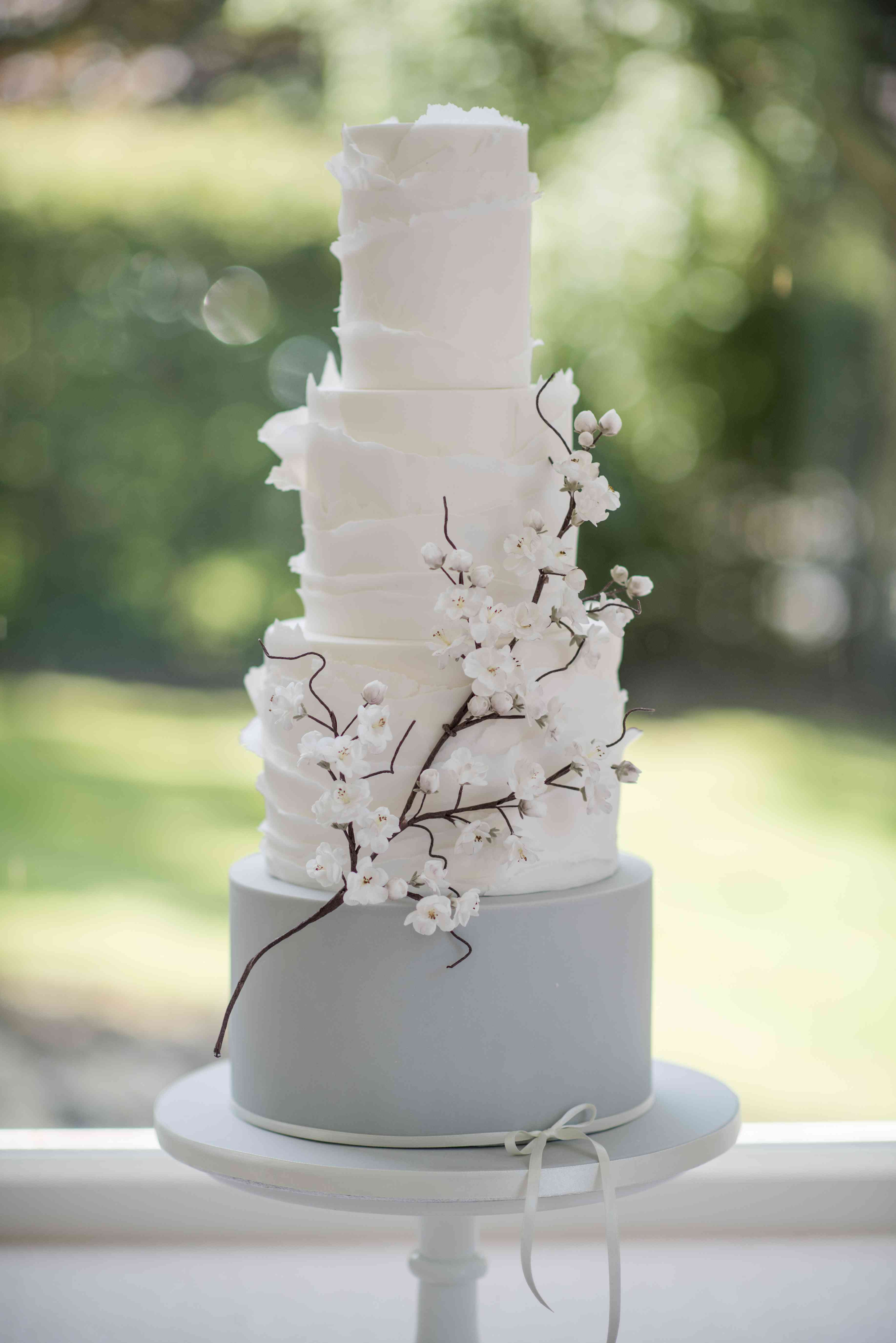 white and gray cherry blossom cake