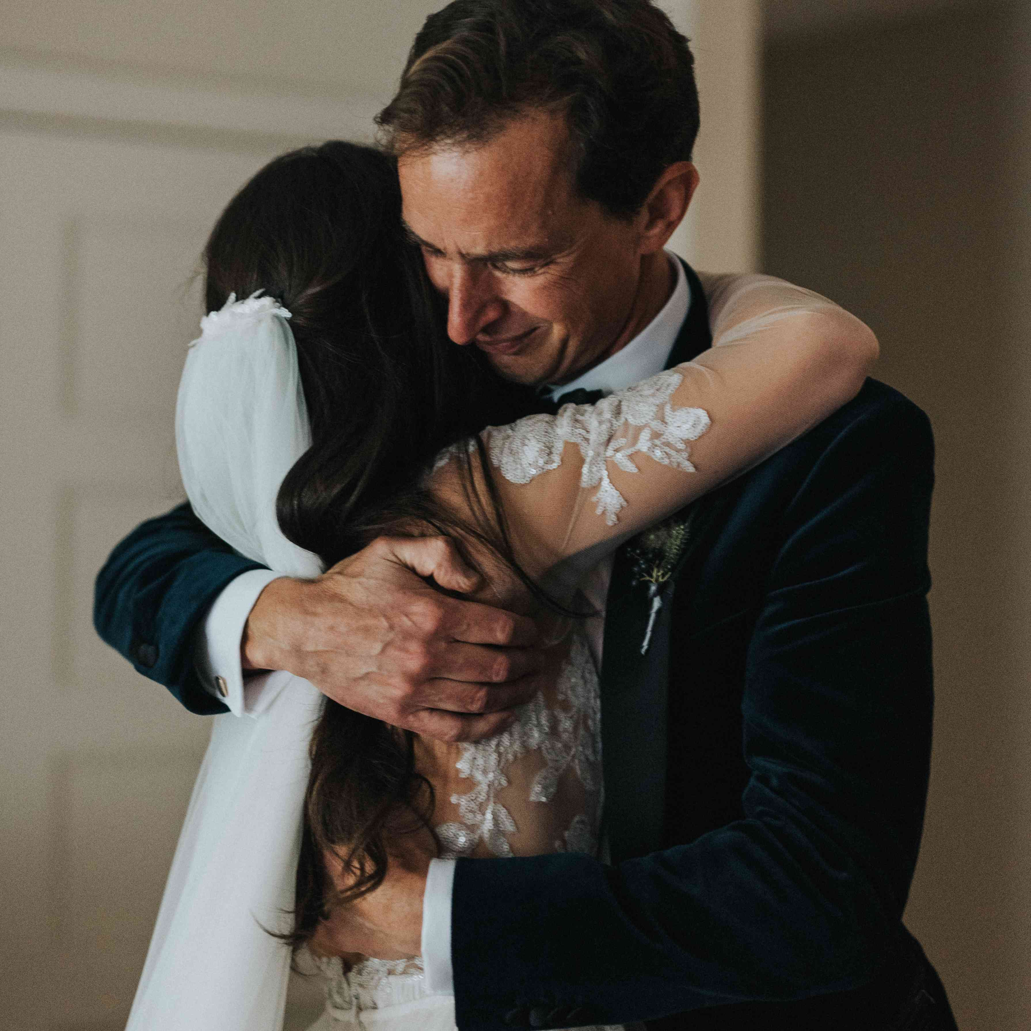 personalized michigan wedding, bride hugging father