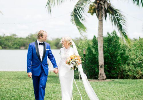 Bride and groom walking in Key West.