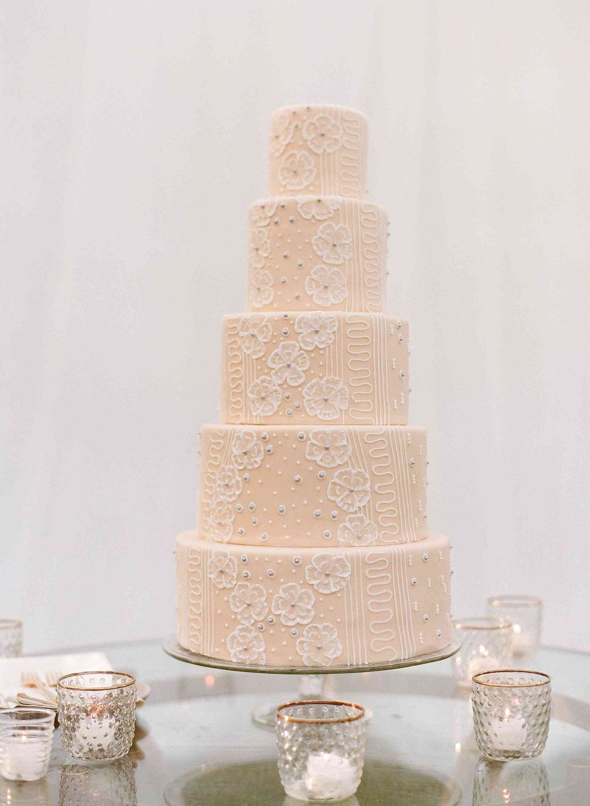 peach wedding cake with detailing