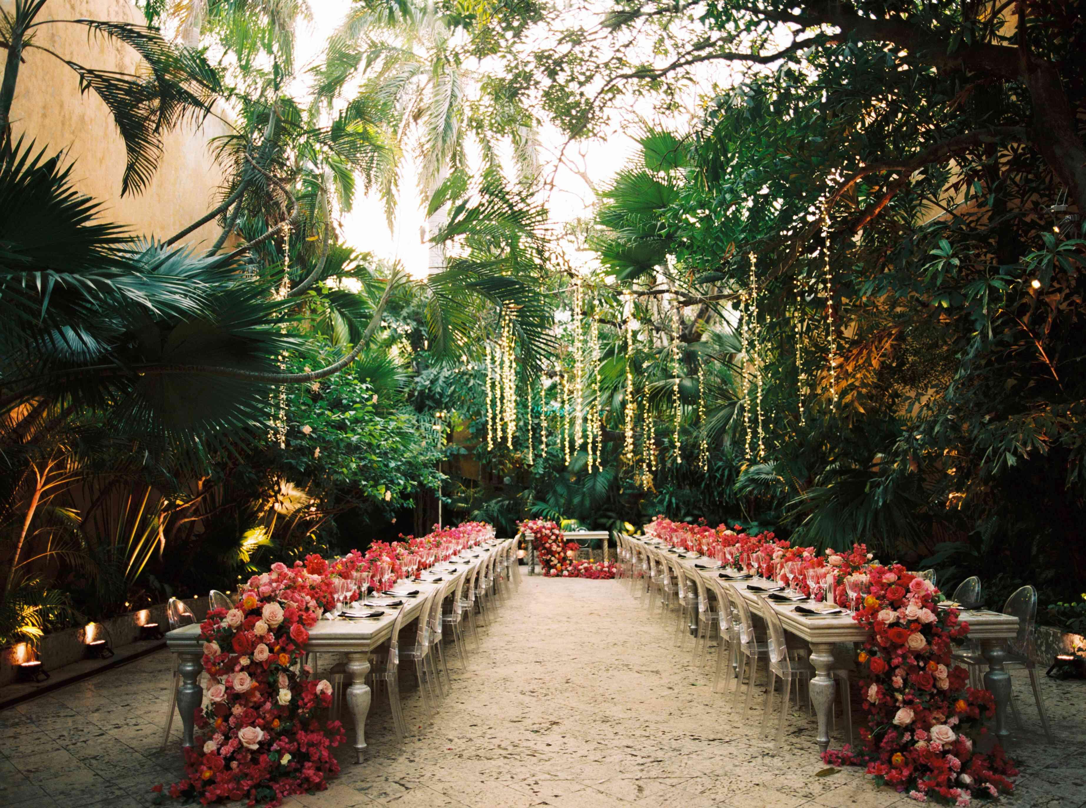 Bougainvillea table runners in verdant jungle setting