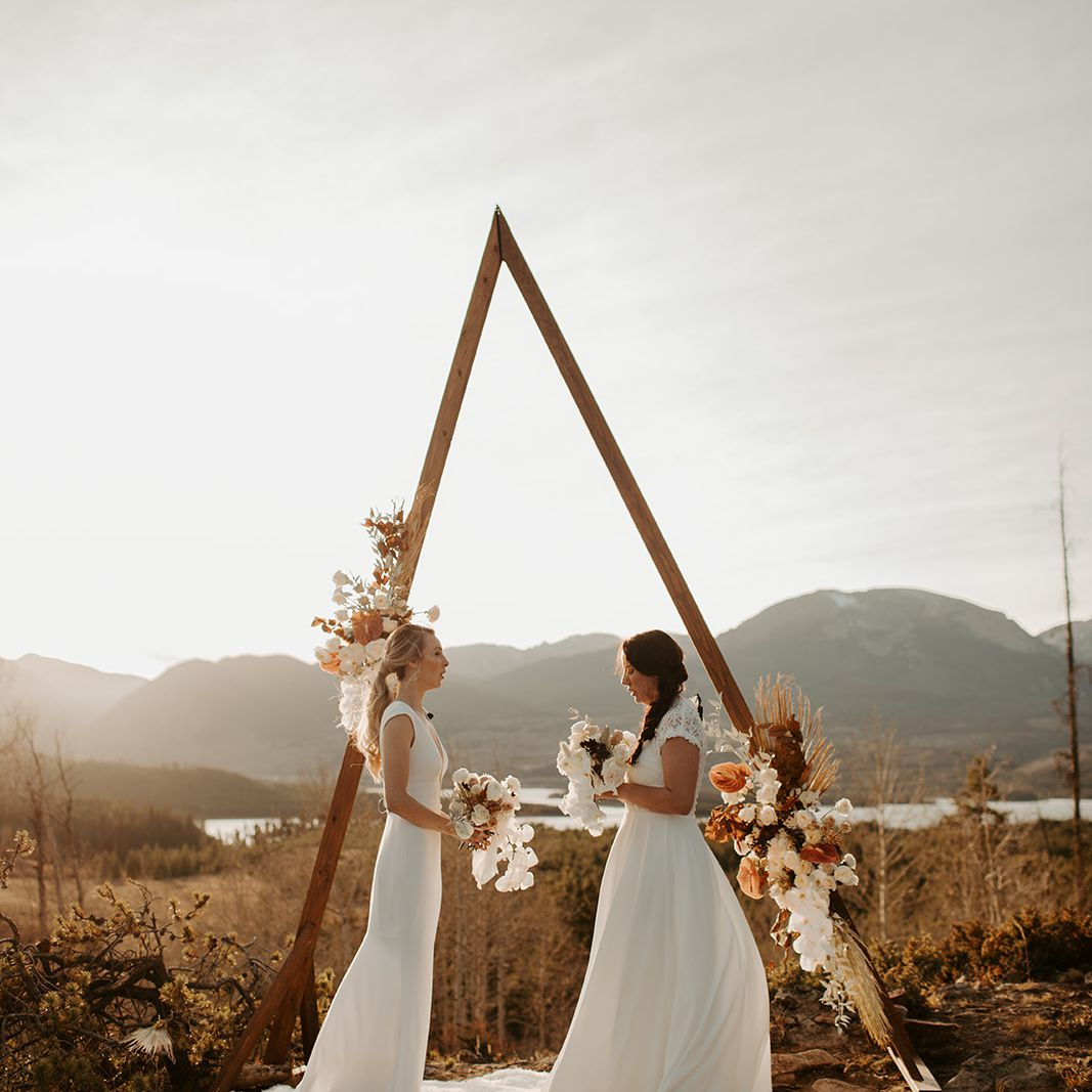 Brides with bouquets at altar