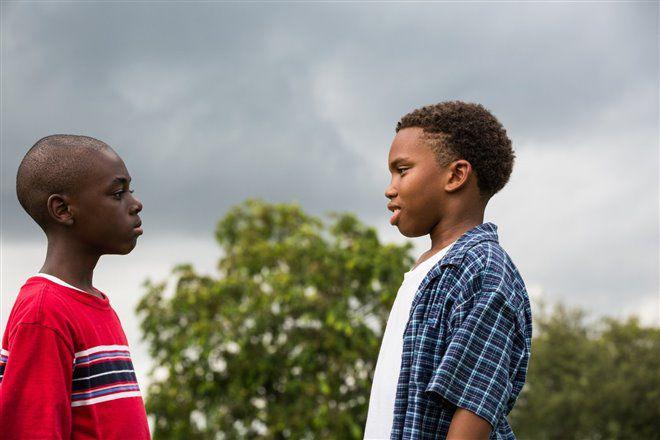 Alex R. Hibbert and Jaden Piner facing one another, movie still from Moonlight (2016)