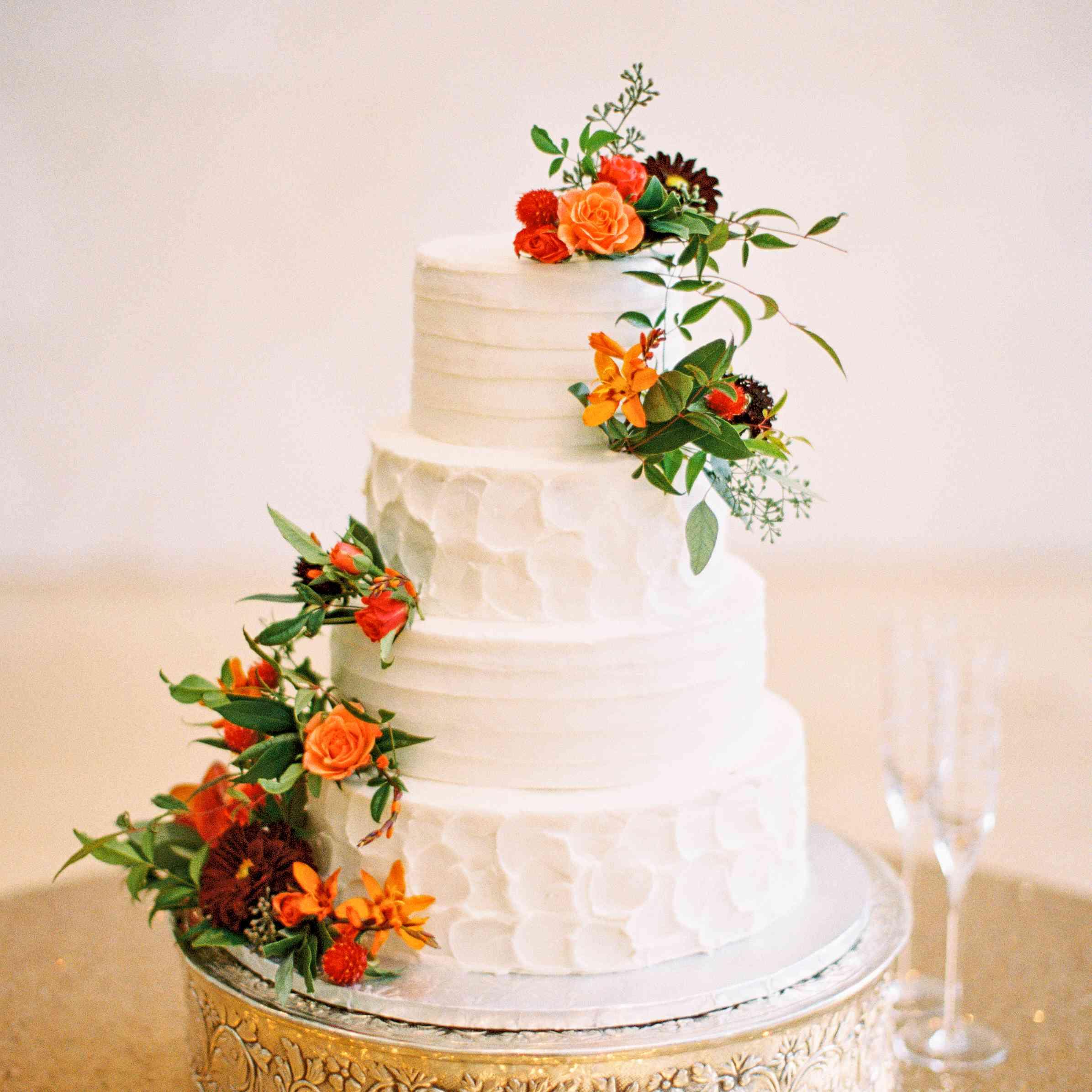 White Wedding Cake with Orange Roses