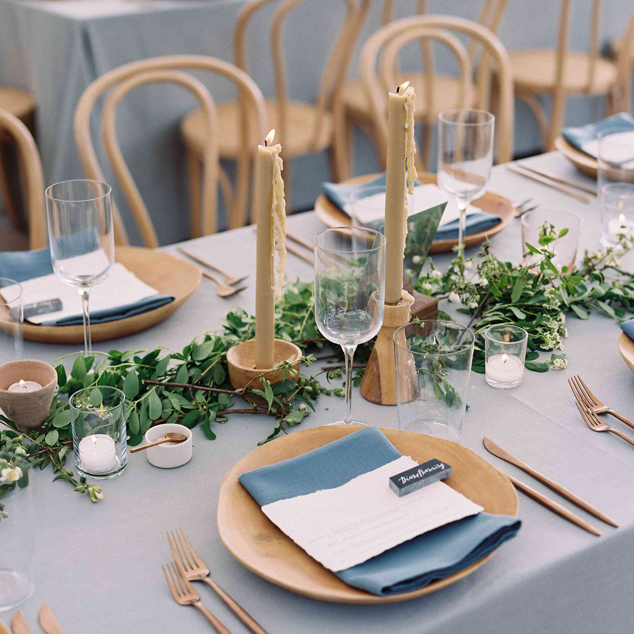 Nude candles on table setting