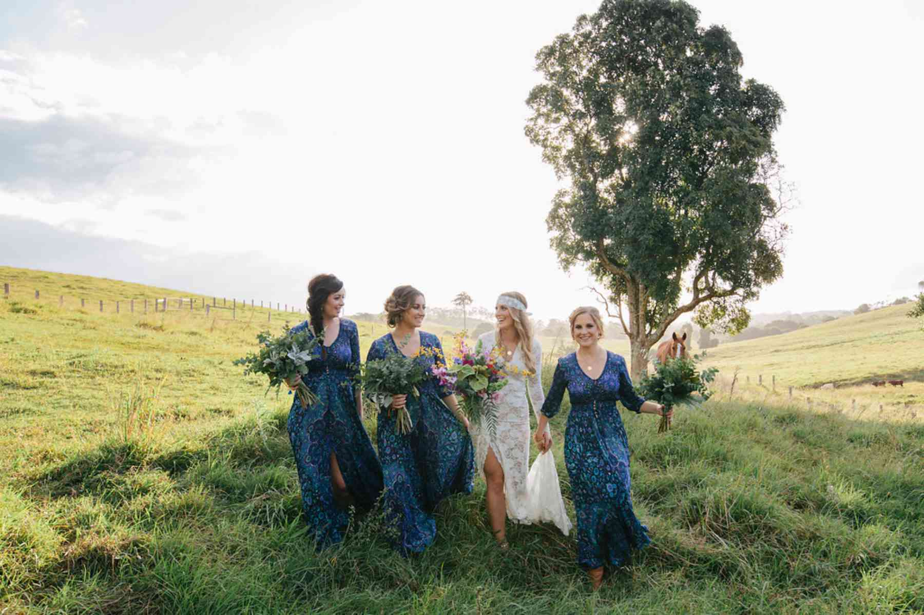 Bridesmaids wearing paisley printed dresses that evoke the countryside.