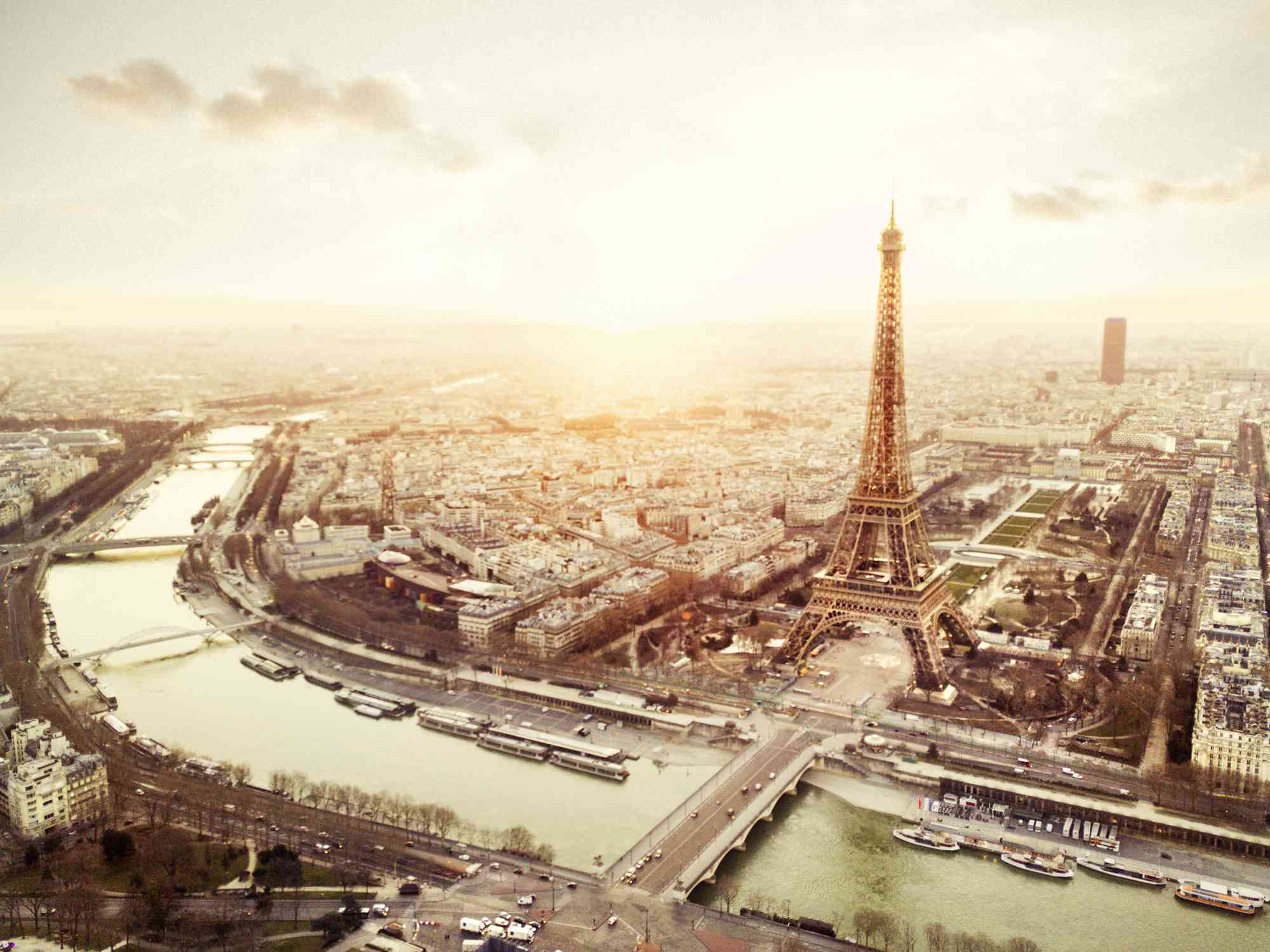 Sky view of the Eiffel Tower and the Seine at sunet