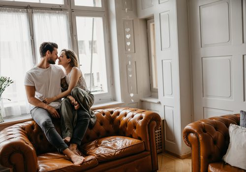 Couple at home on couch