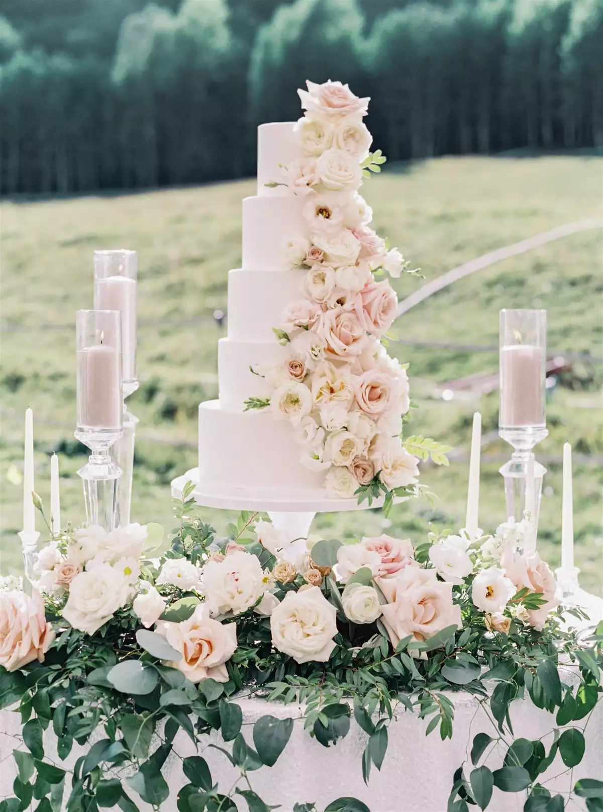 wedding cake with roses and greenery