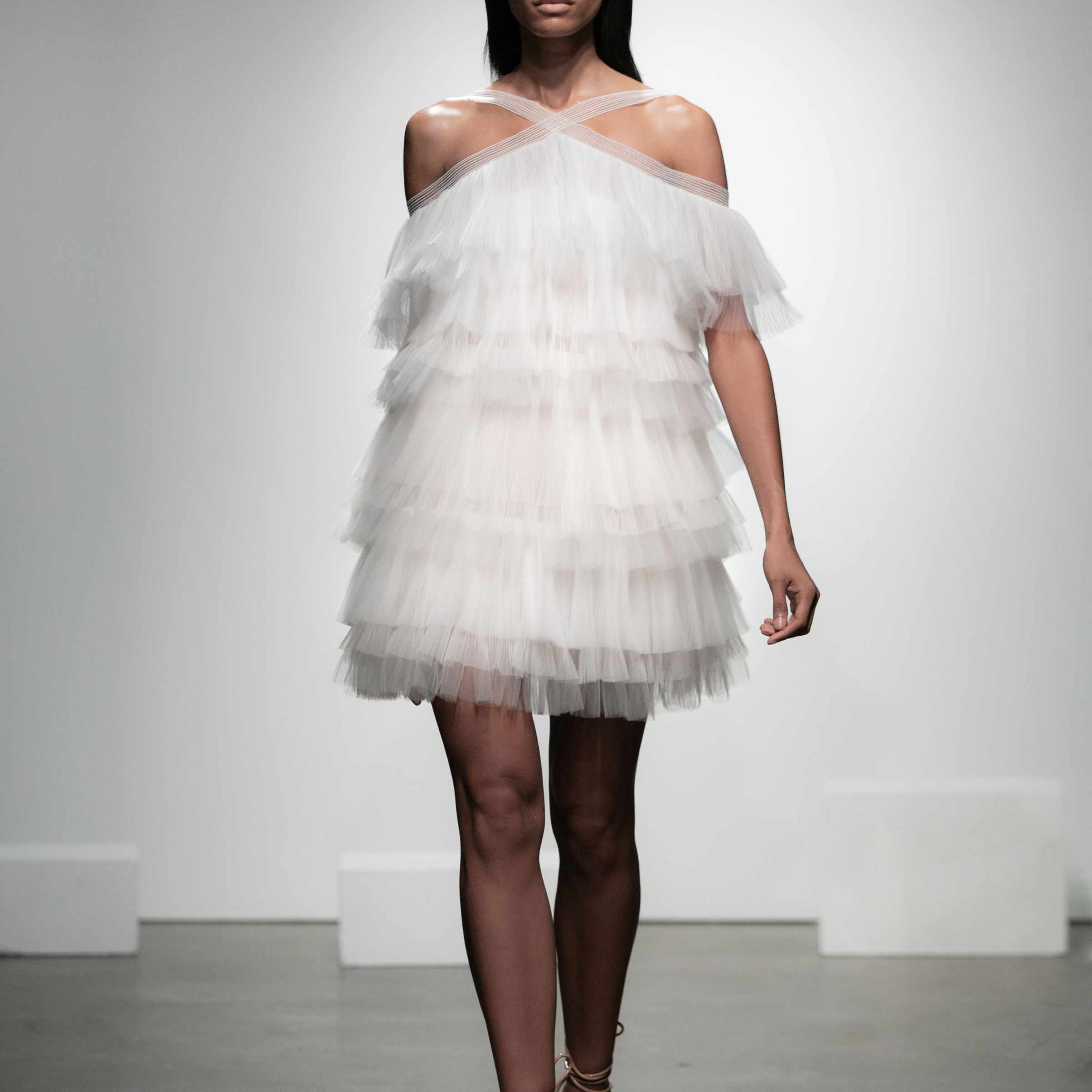 Model in layered tulle mini dress