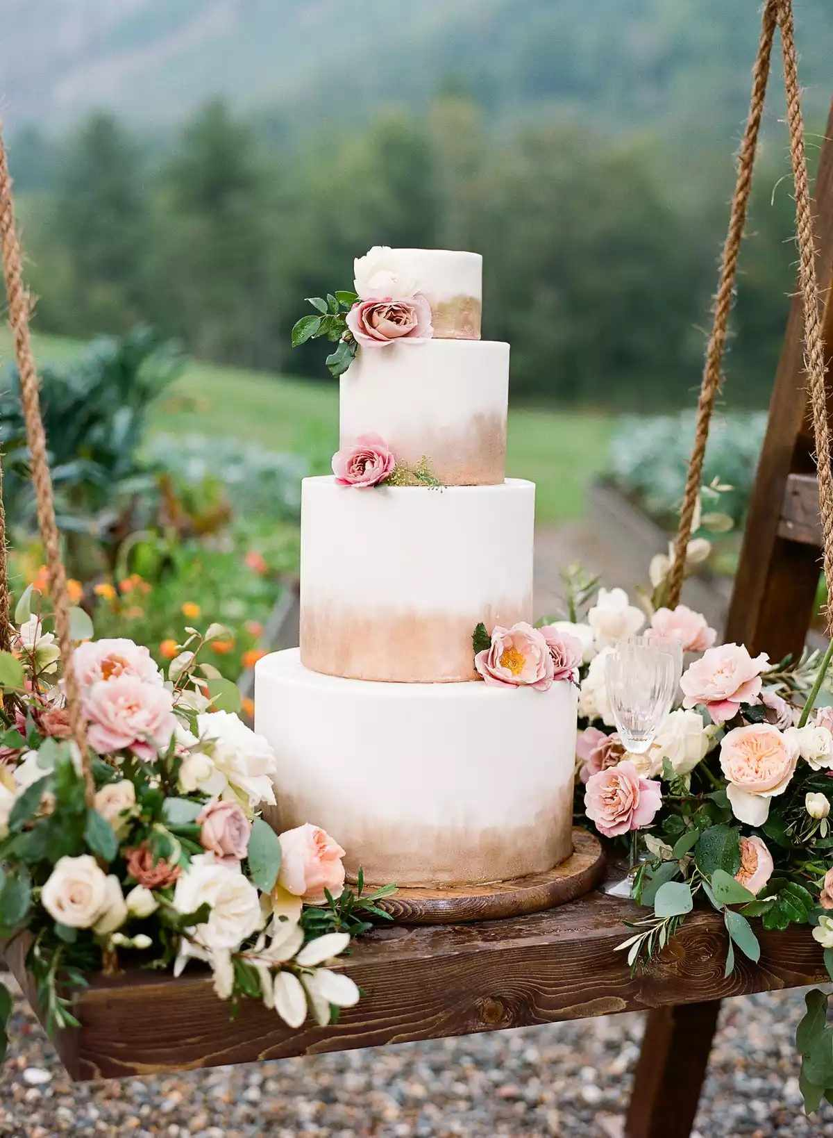 wedding cake suspended on a swing