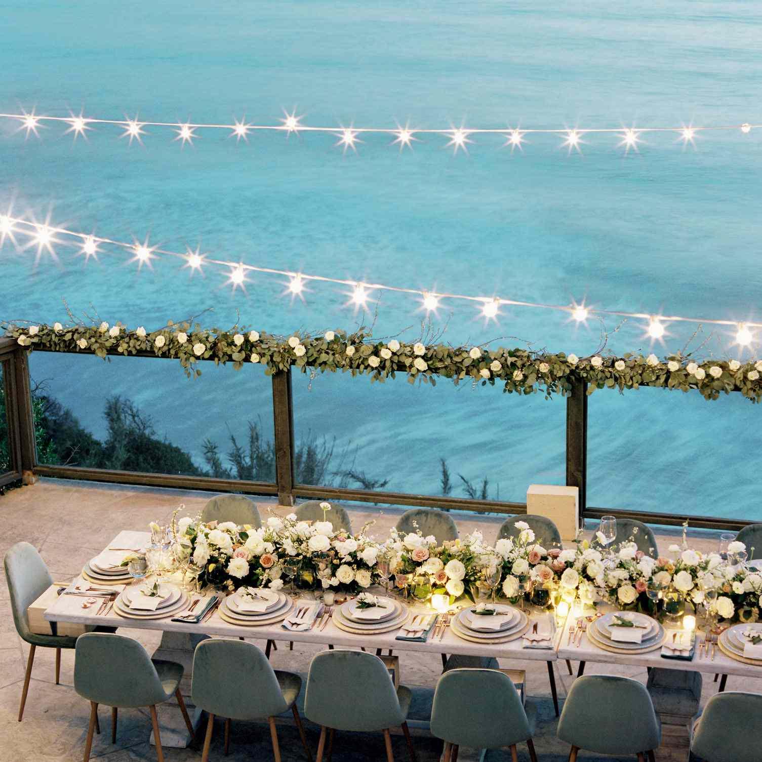 Ocea-side dinner with string lights