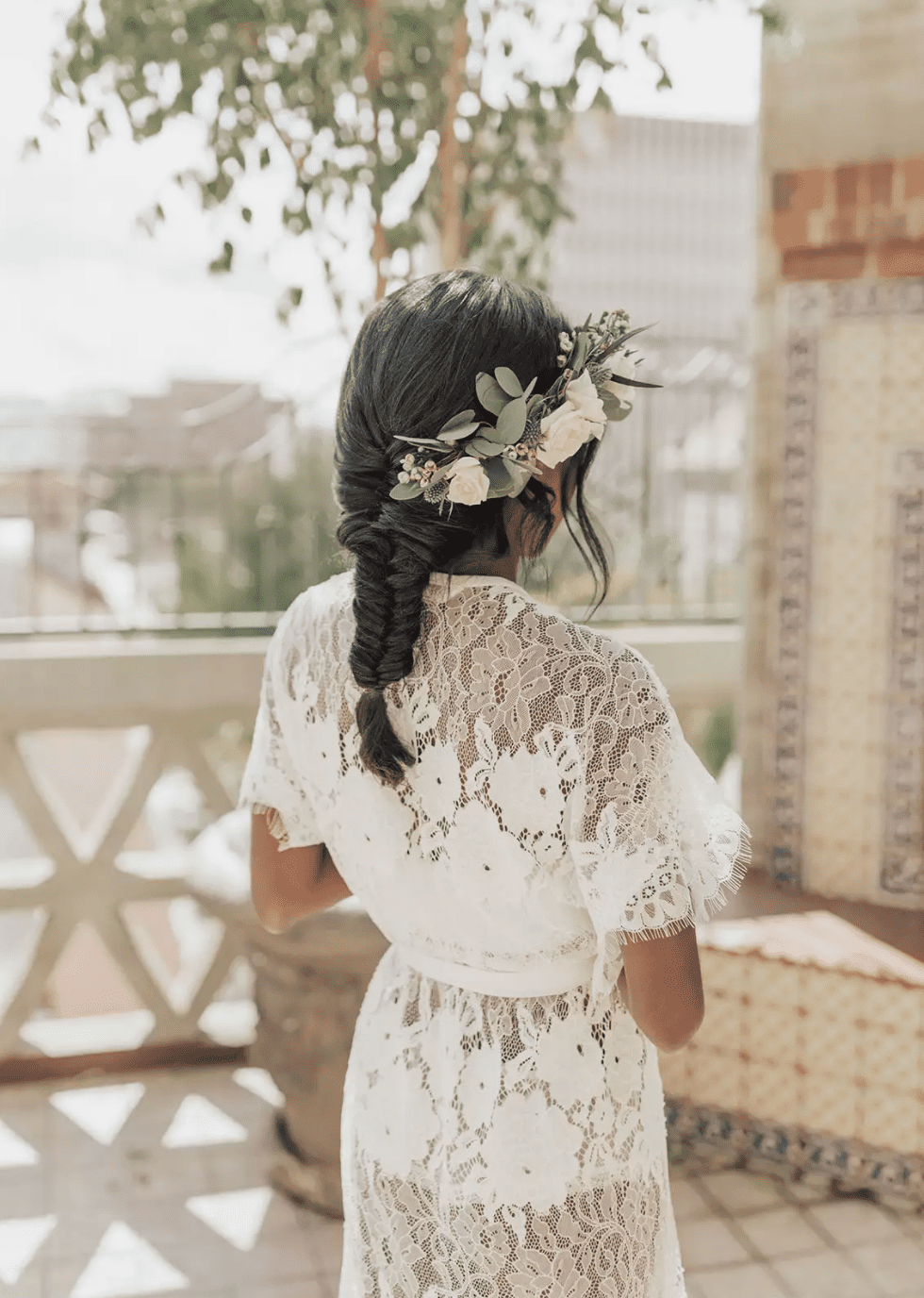 Fishtail braid with floral adornment