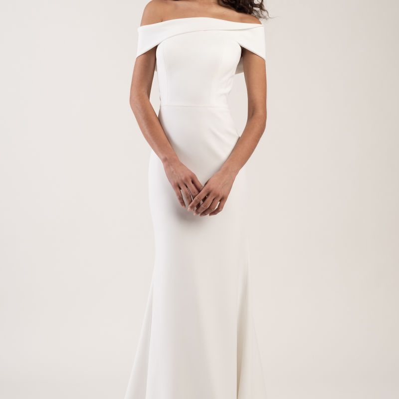 Model in crepe off-the-shoulder gown