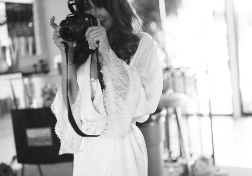 bride holding camera