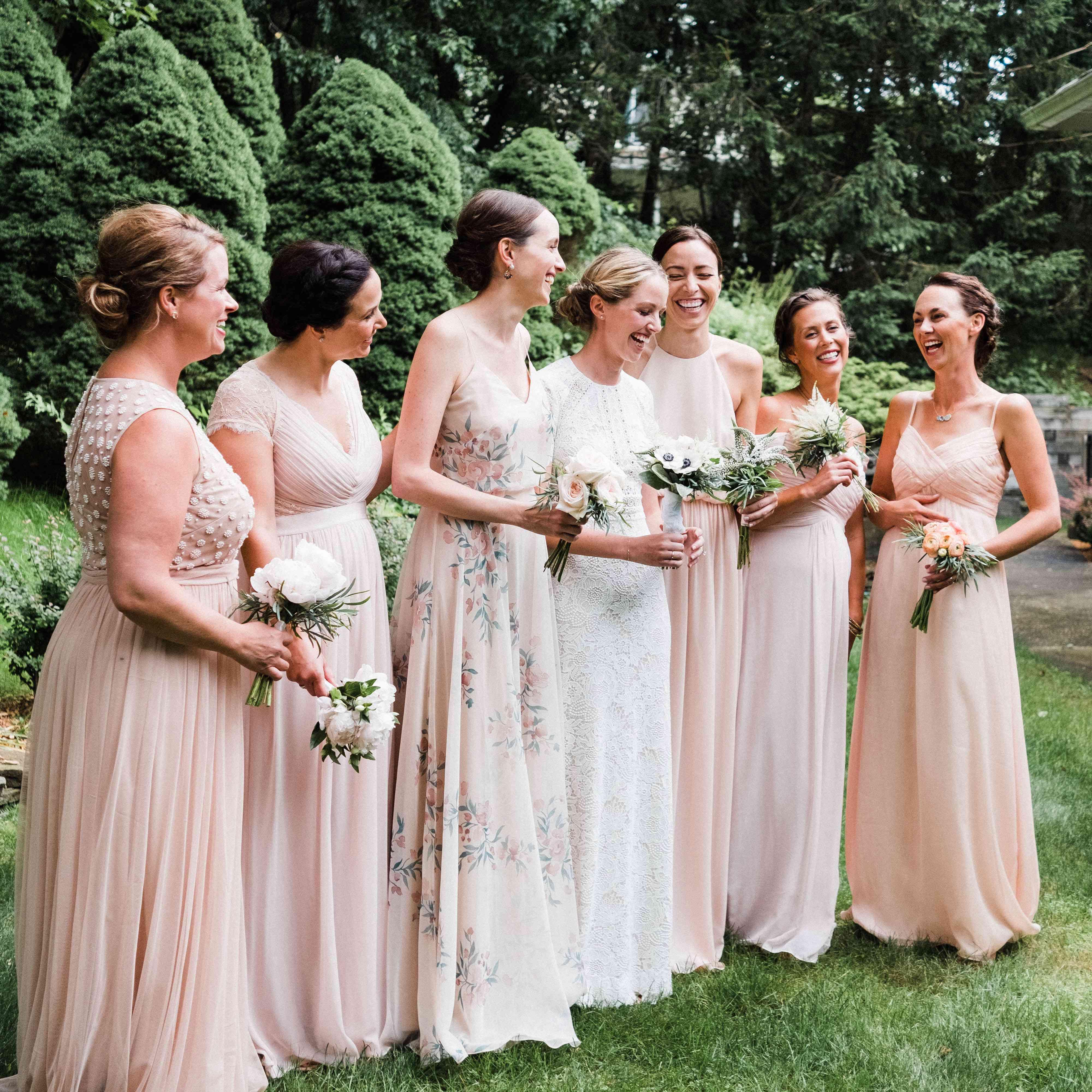 <p>bridesmaids in mismatched blush dresses</p><br><br>