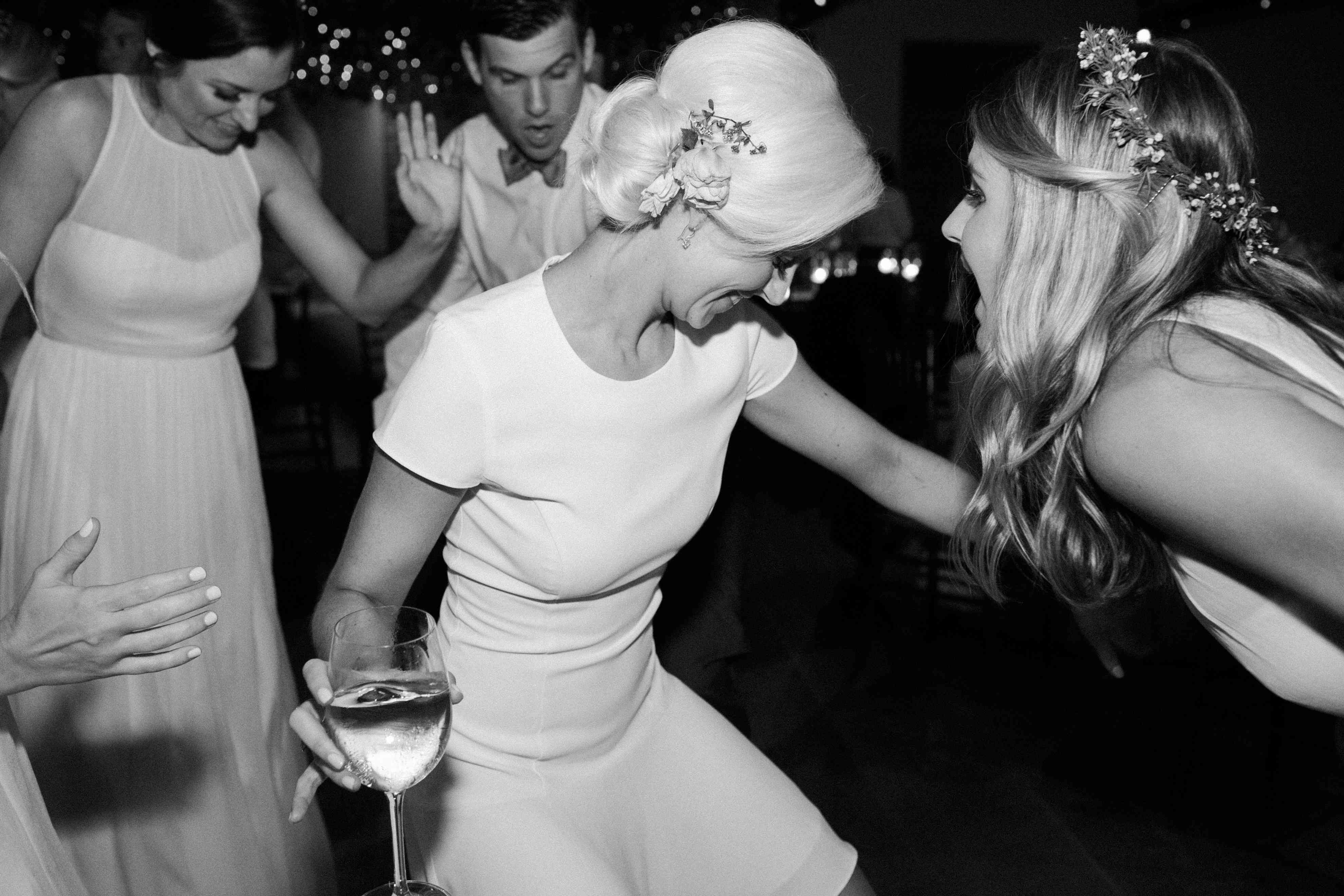 <p>Bride dancing with wine glass</p><br><br>