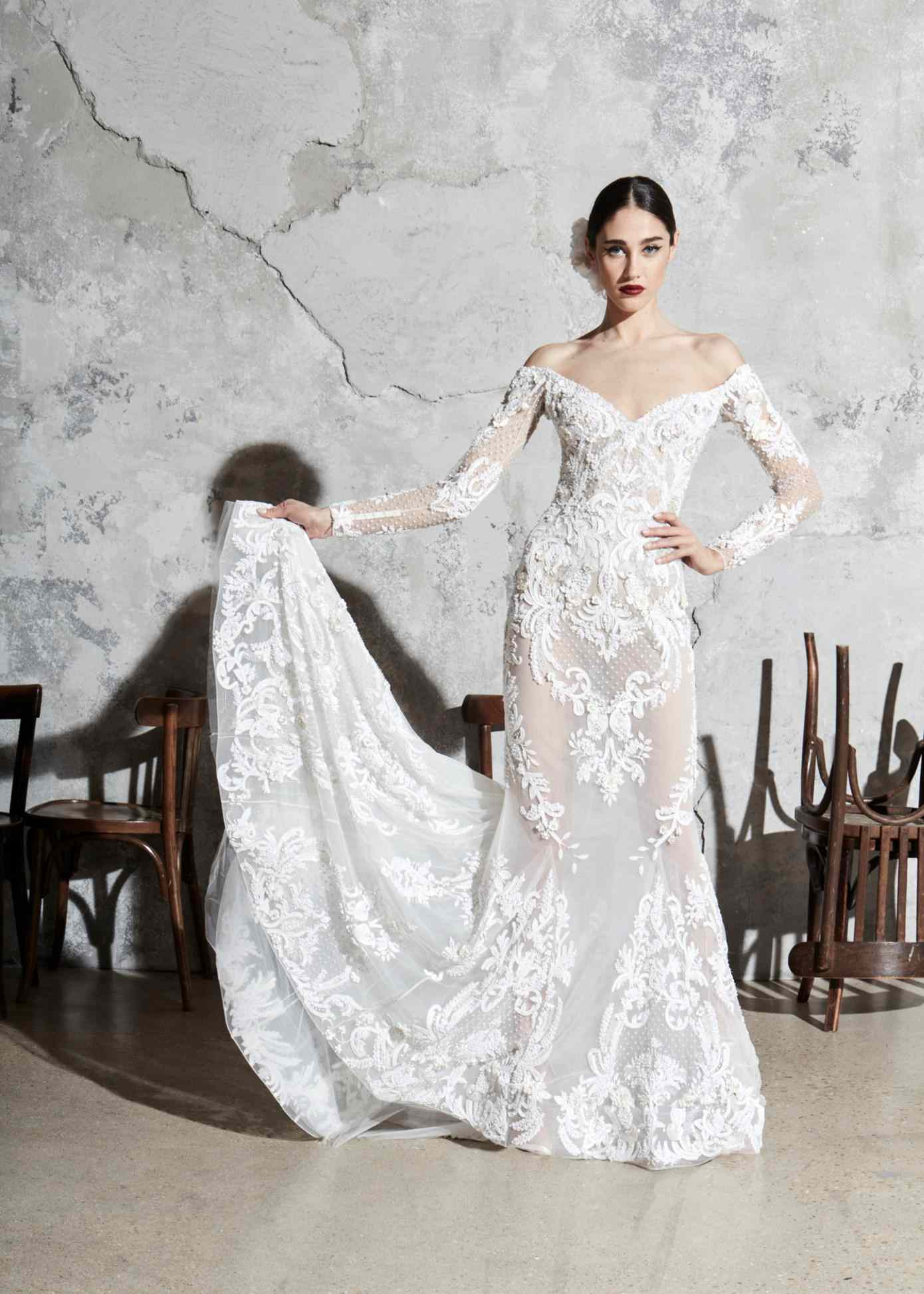 Model in off-the-shoulder long-sleeve embroidered silk organza mermaid gown with appliques