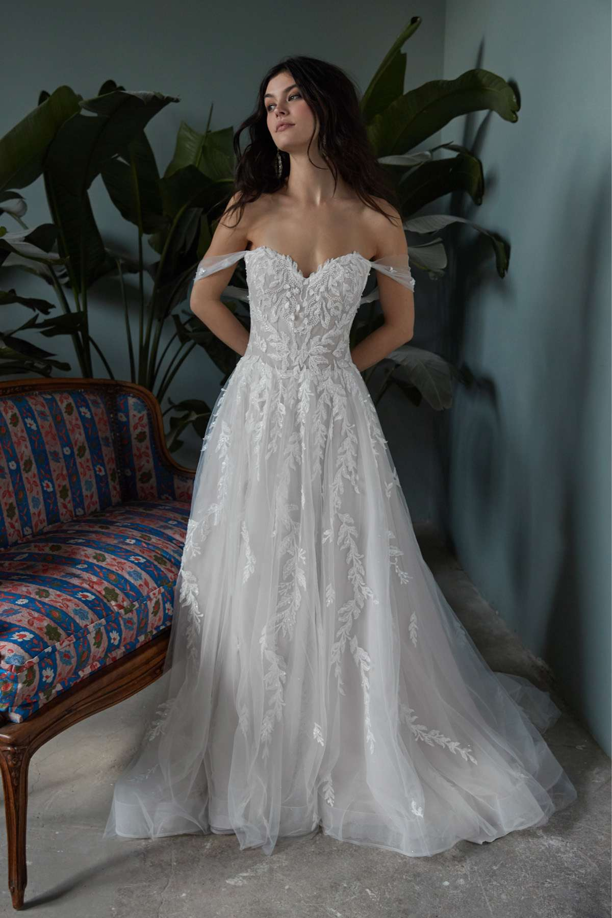 Model in off-the-shoulder sweetheart ballgown with 3D floral embroidery