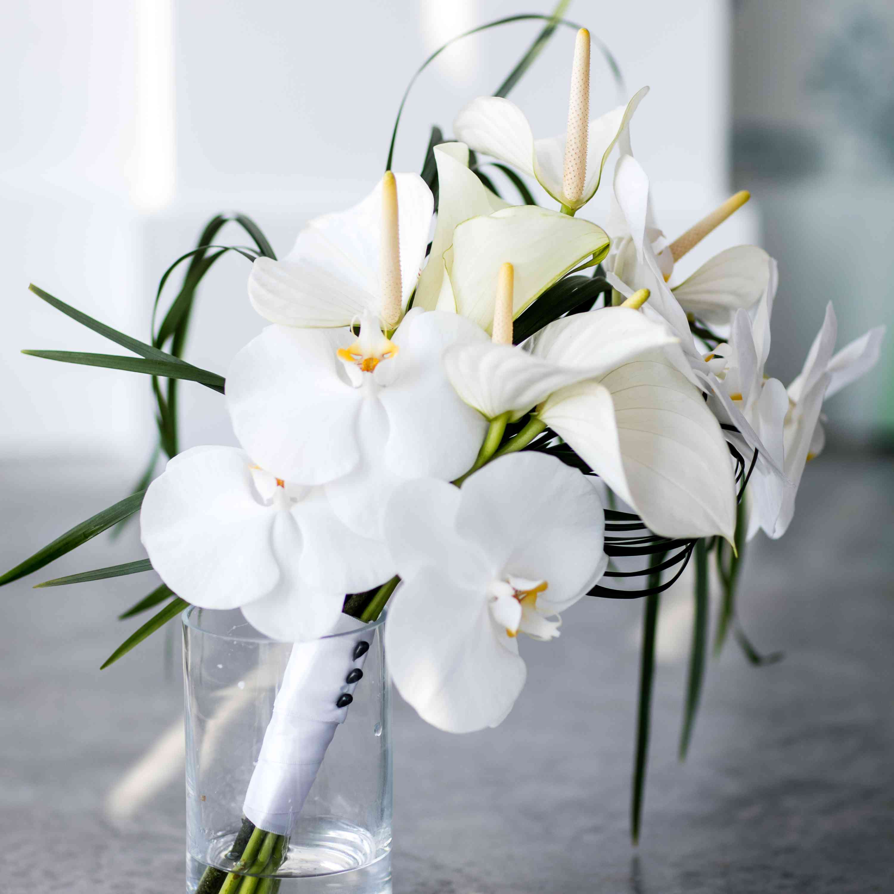 Bouquet of white lilies and orchids