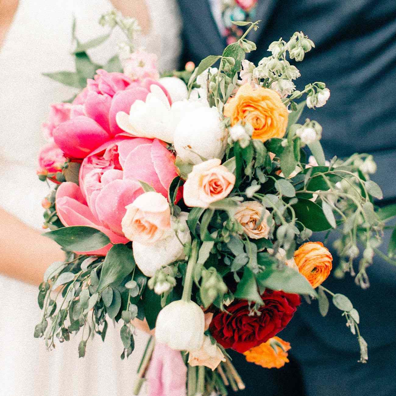Peony bouquet with pops of crimson