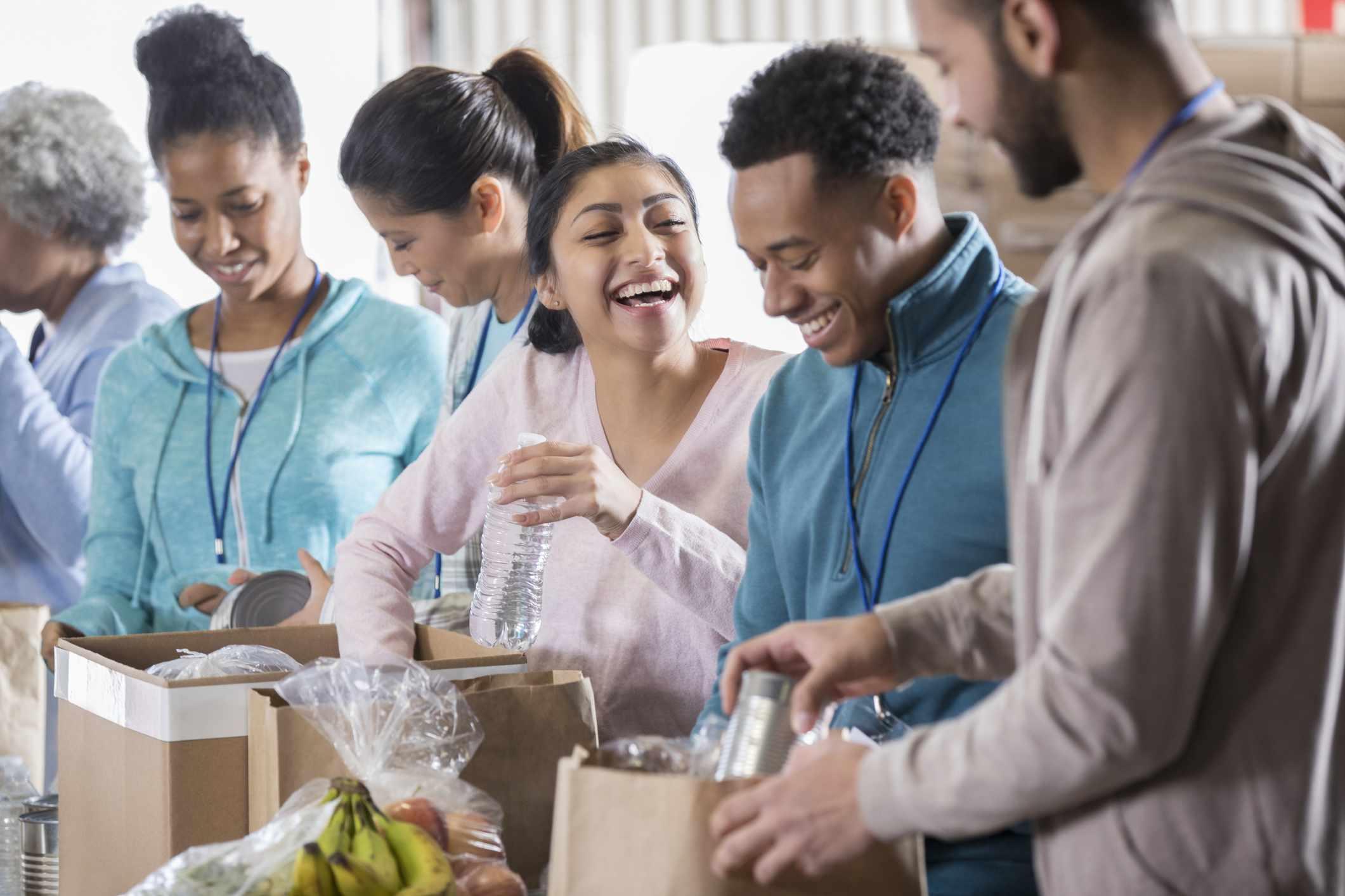 People volunteering at a food drive