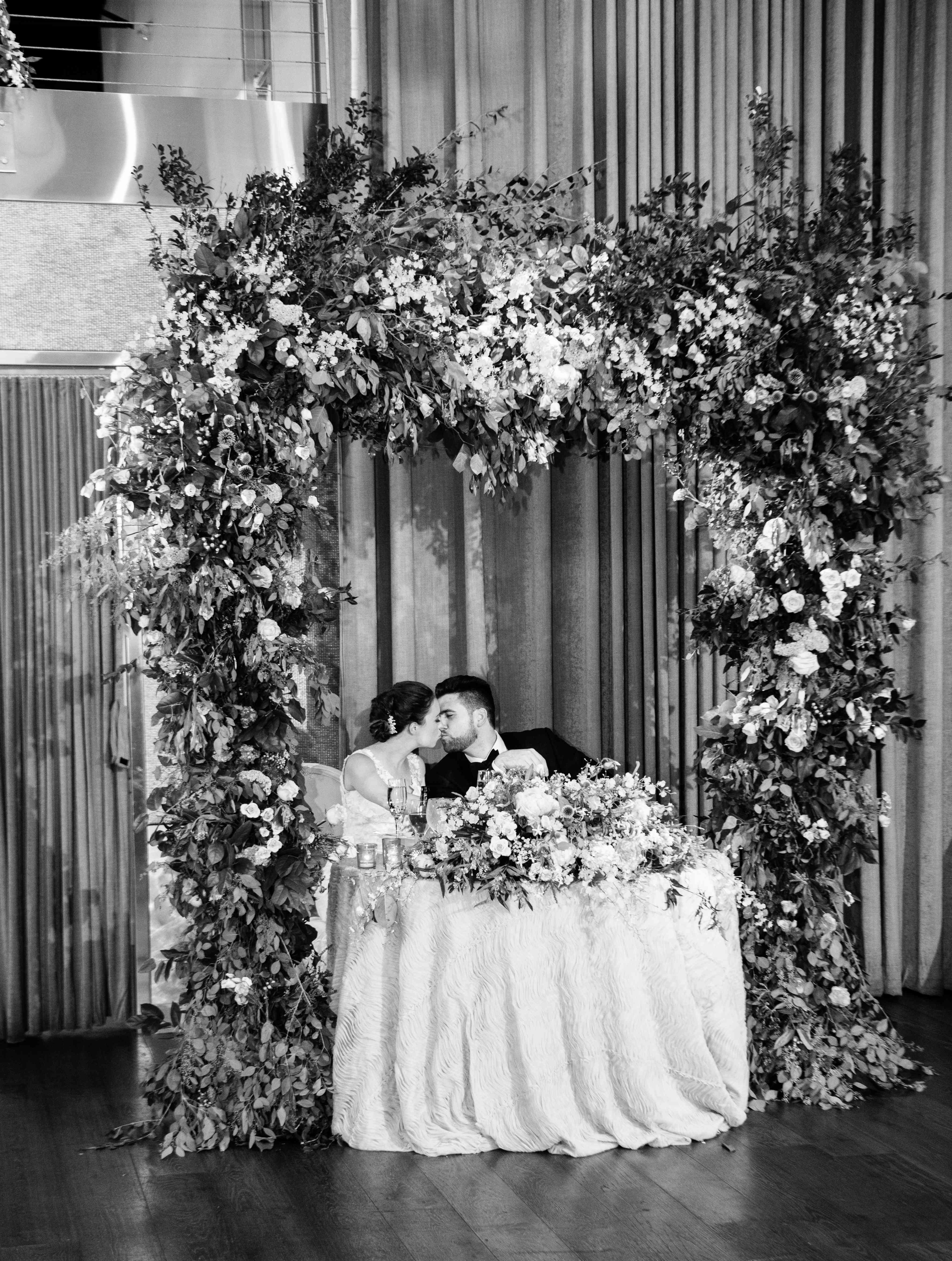 <p>sweetheart table with floral arch</p><br><br>