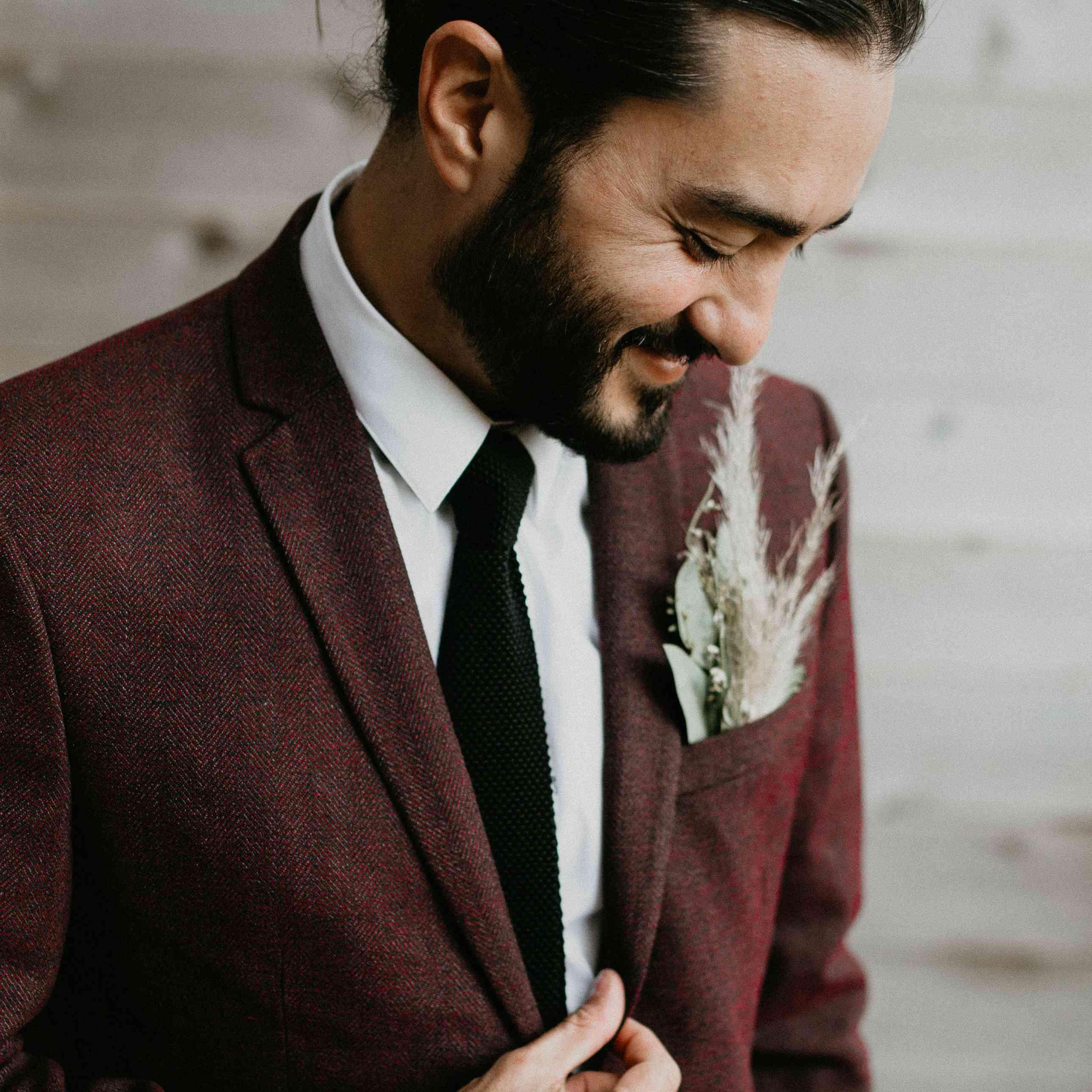 <p>groom man bun burgundy suit</p><br><br>