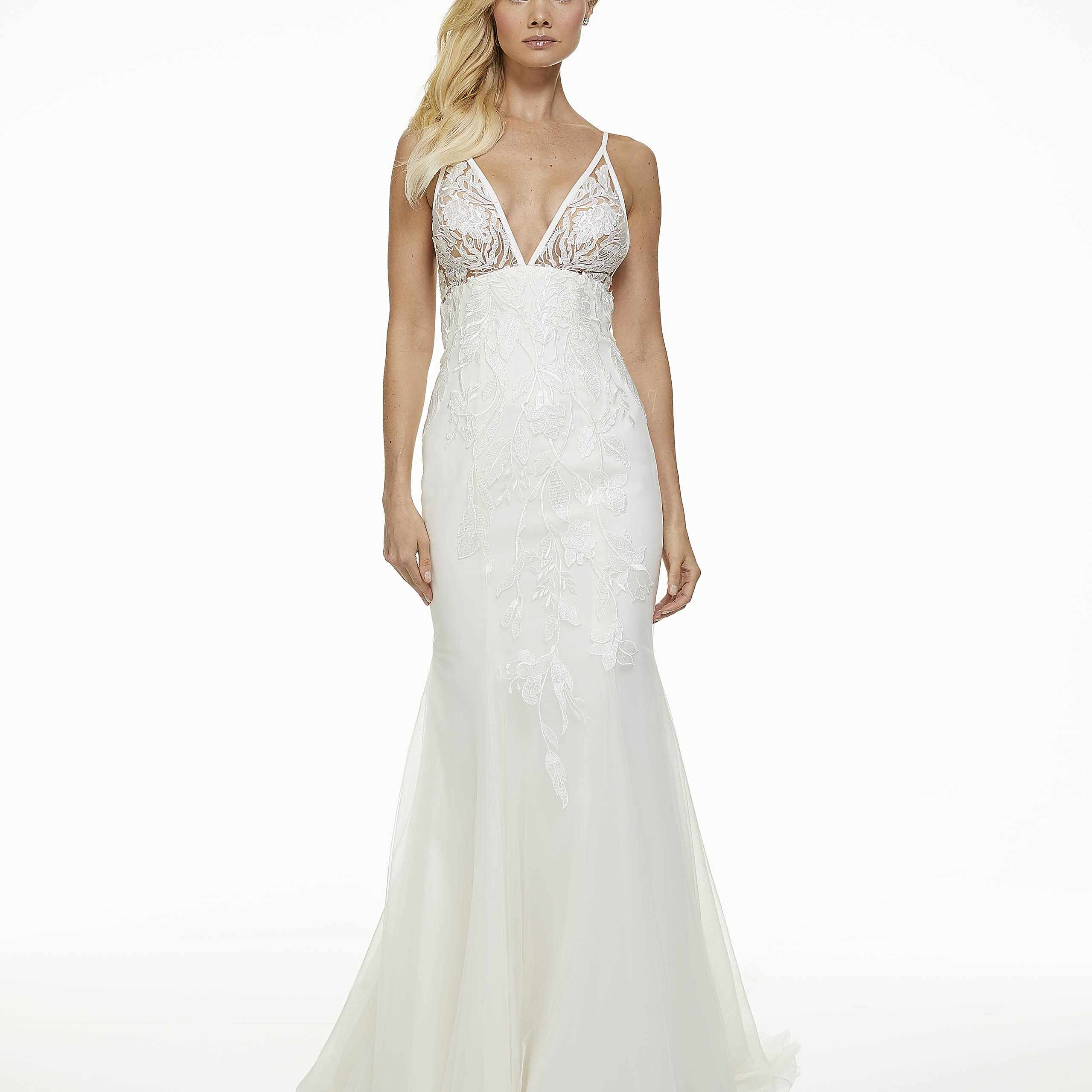 Model in fit-and-flare empire wedding dress
