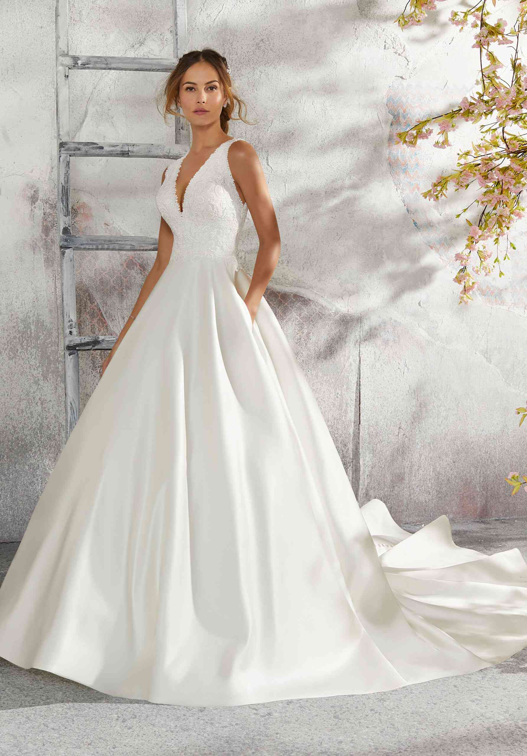 Model in deep V bridal ball gown with pockets