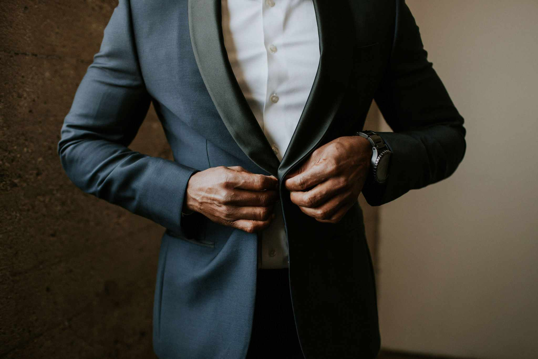groom buttoning suit