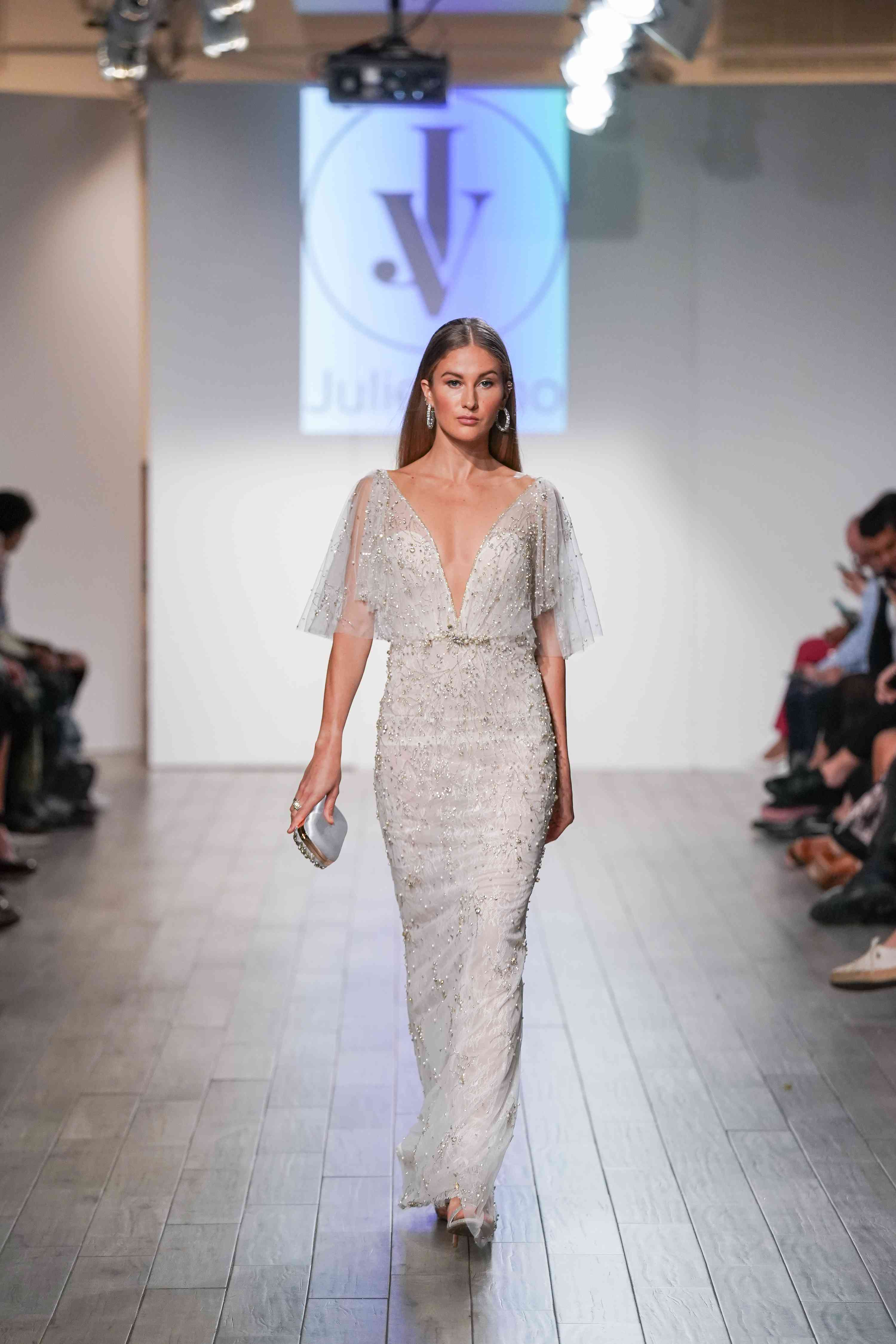 Model in fitted flutter sleeve wedding dress