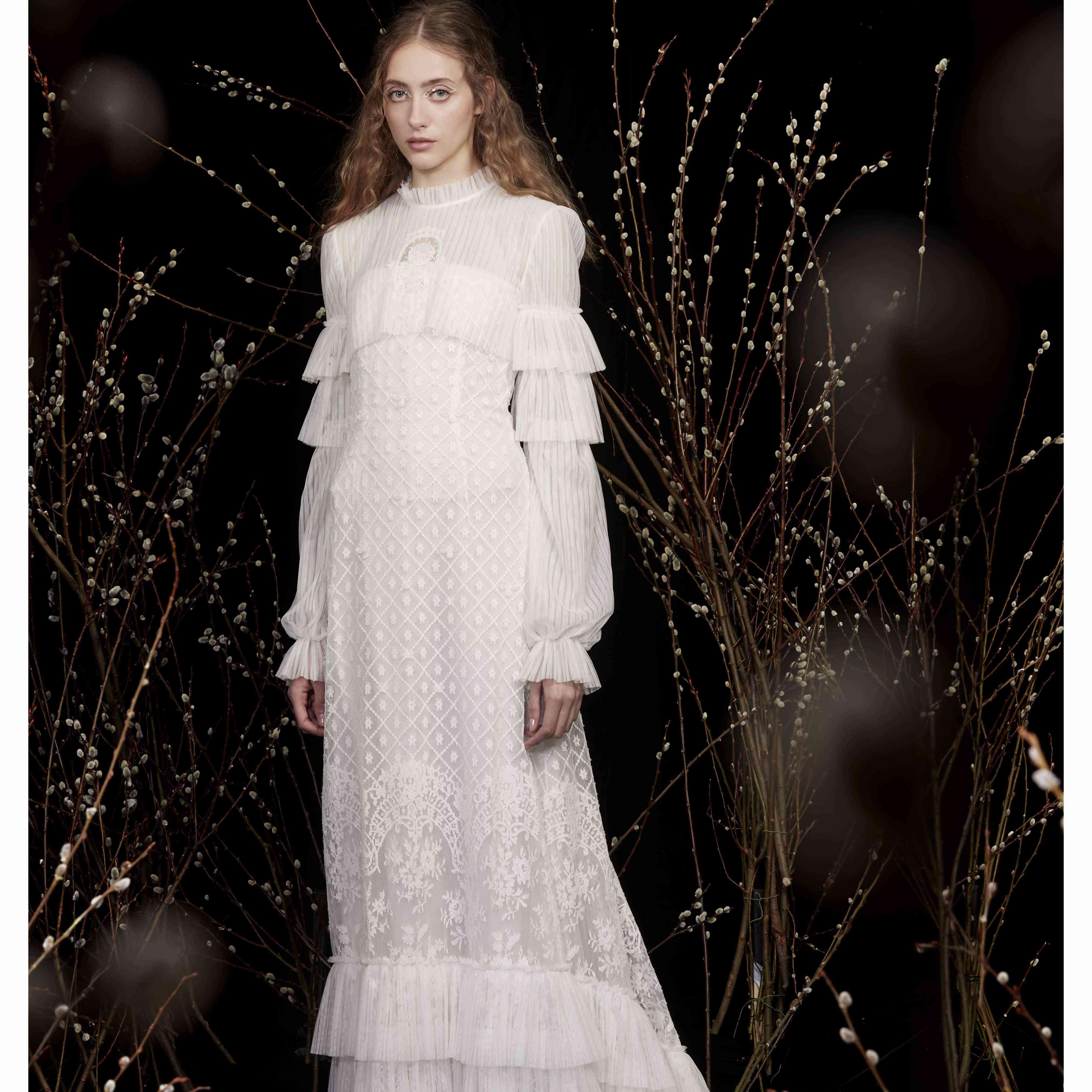 Model in long sleeves ruffle neck wedding dress