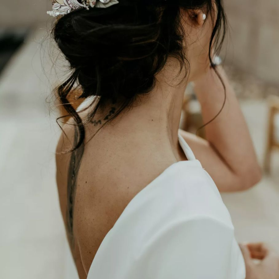 Messy bun with large headpiece hugging the back of the head
