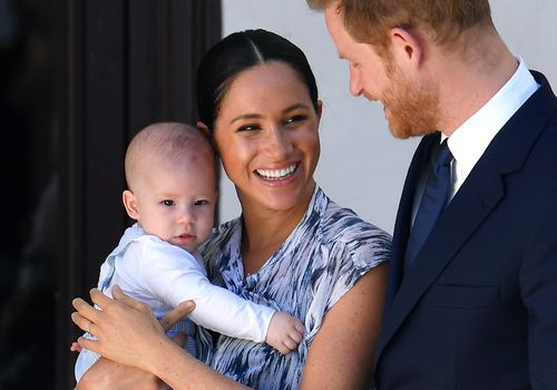 Meghan Markle holding son with Prince Harry
