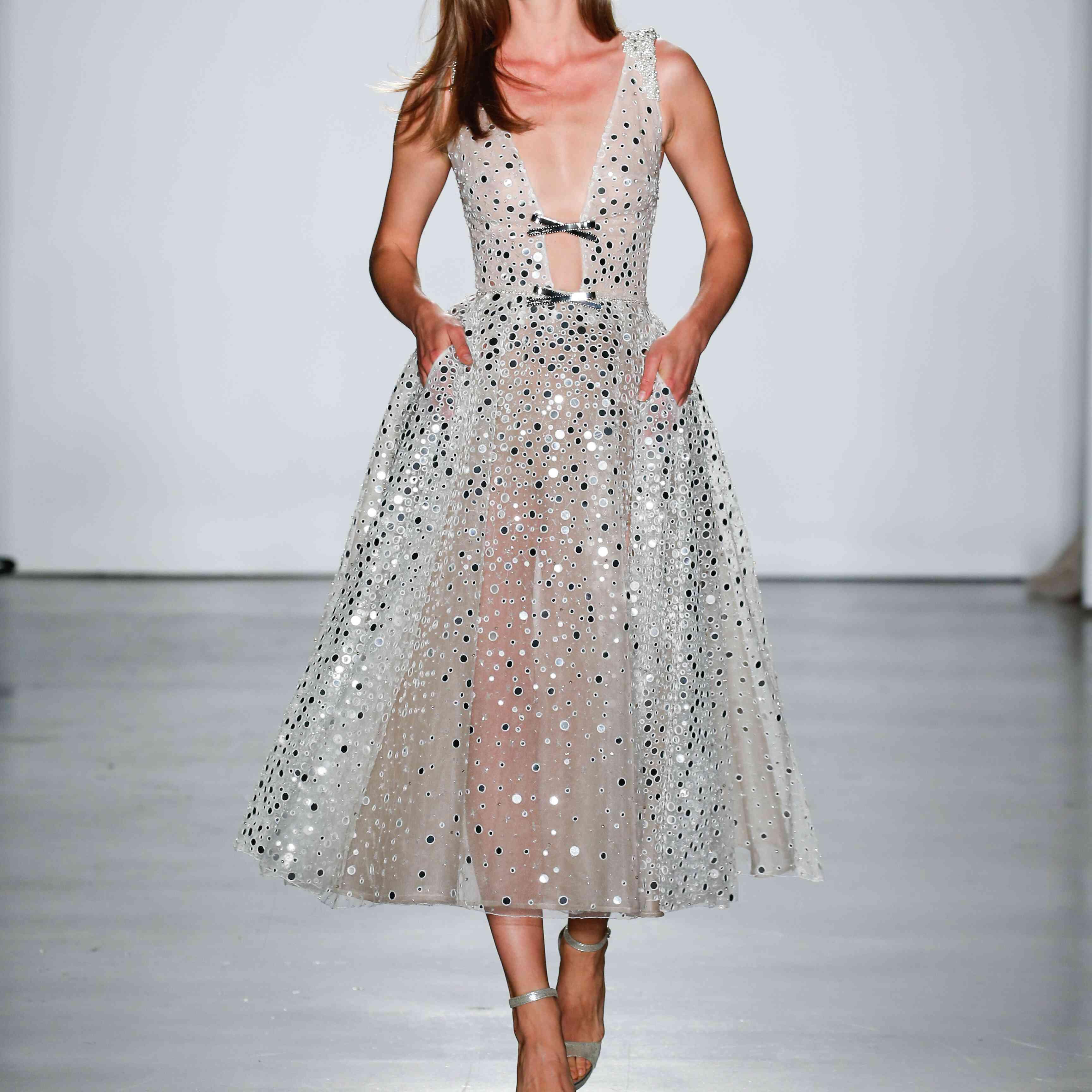 Model in tea-length embellished wedding dress